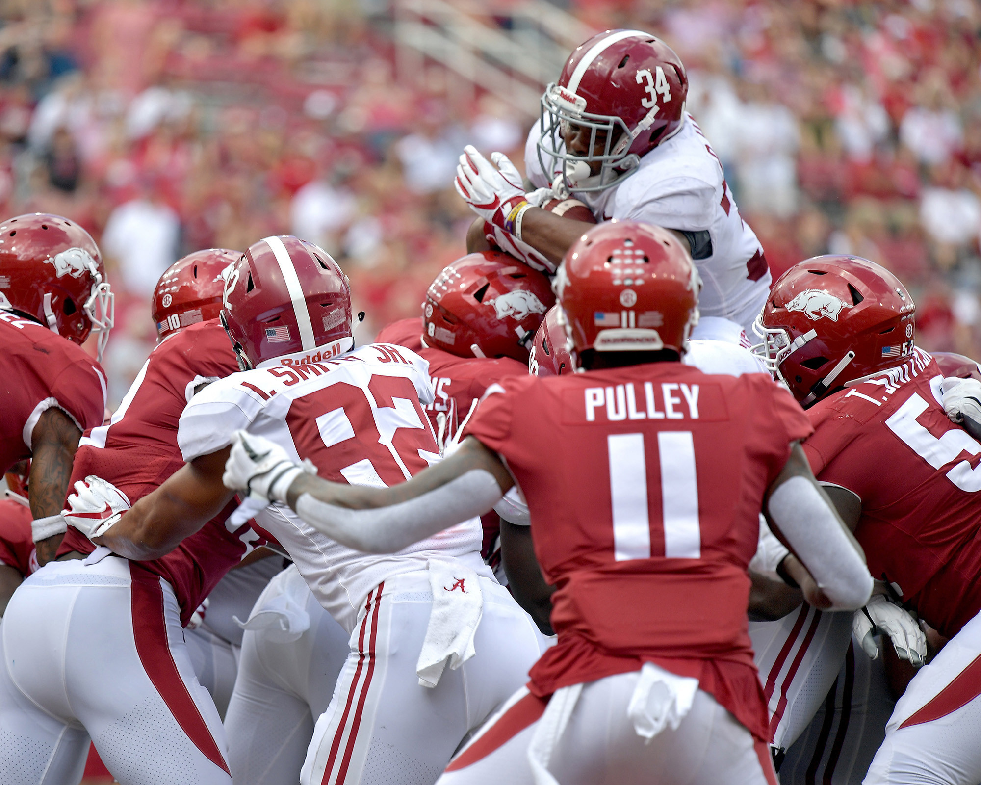 Alabama Crimson Tide running back Damien Harris (34) on his way to another touchdown during the second half of the NCAA football game against the Arkansas Razorbacks at Razorback Stadium on Oct. 6, 2018, in Fayetteville, Ark. Alabama defeated Arkansas 65-31. (Photo by Lee Walls)