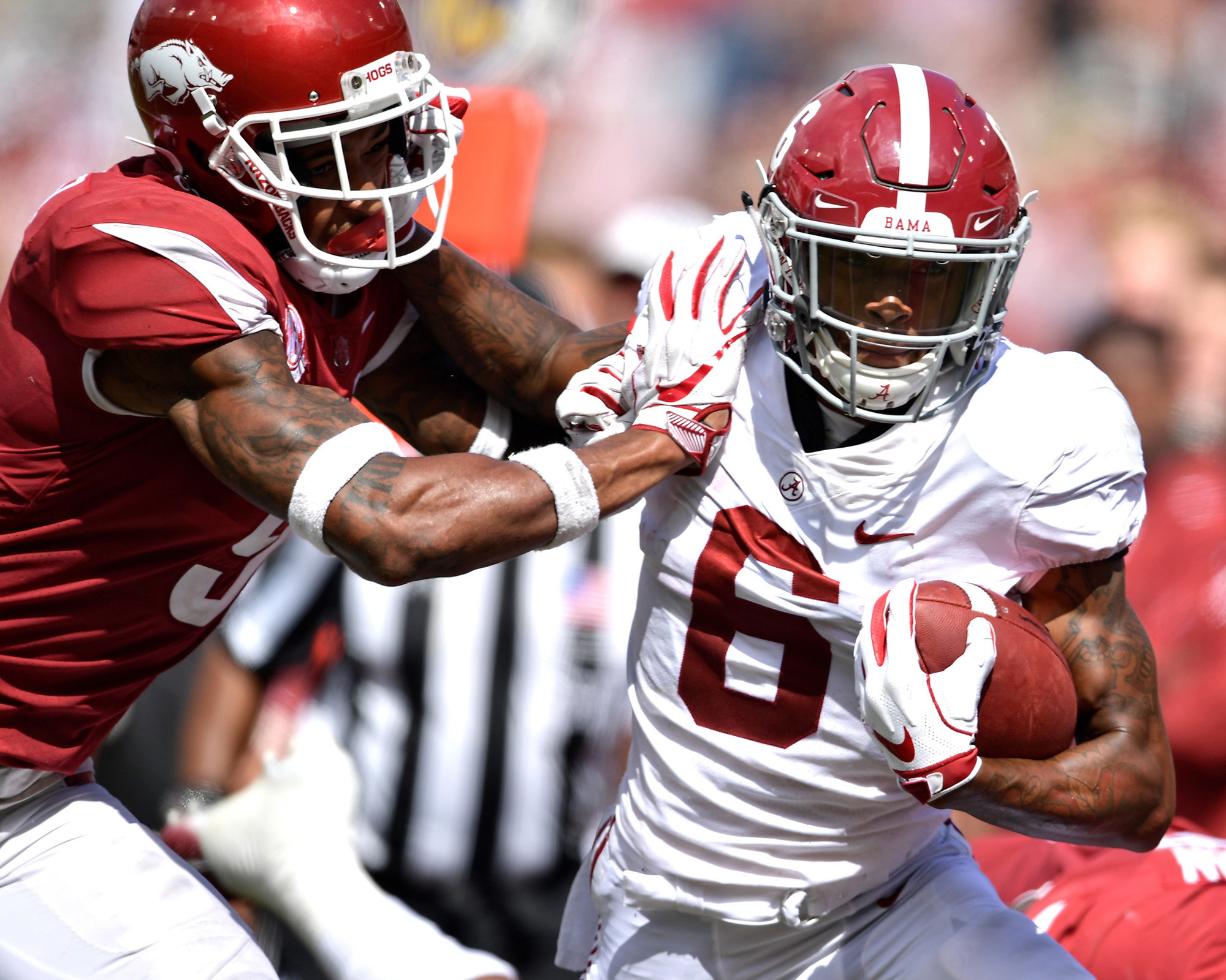 Alabama Crimson Tide wide receiver DeVonta Smith (6) adds yards after the reception in the second half of the NCAA football game against the Arkansas Razorbacks at Razorback Stadium on Oct. 6, 2018, in Fayetteville, Ark. Alabama defeated Arkansas 65-31. (Photo by Lee Walls)