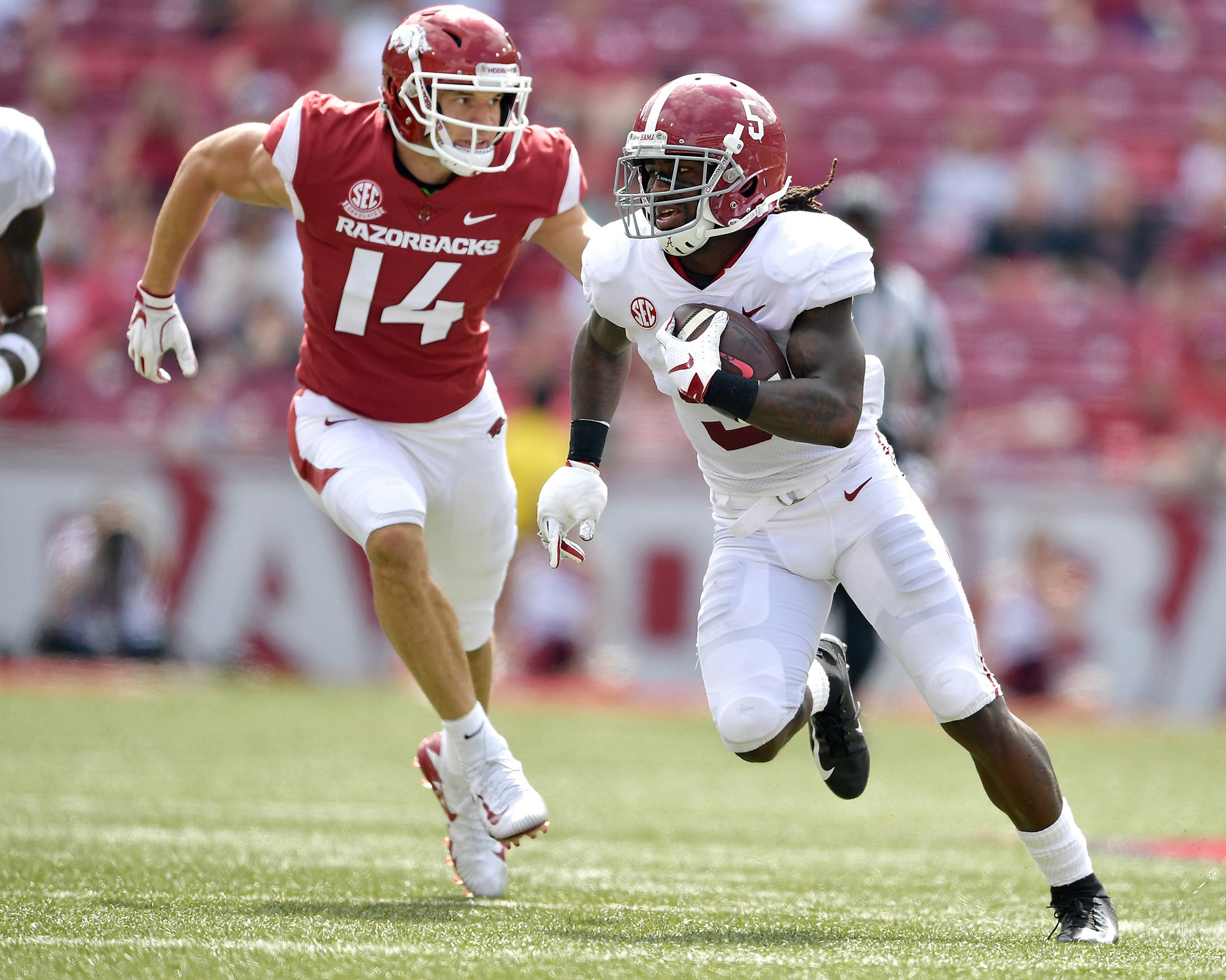Alabama Crimson Tide defensive back Shyheim Carter (5) with a pick-six in the second half of the NCAA football game against the Arkansas Razorbacks at Razorback Stadium on Oct. 6, 2018, in Fayetteville, Ark. Alabama defeated Arkansas 65-31. (Photo by Lee Walls)