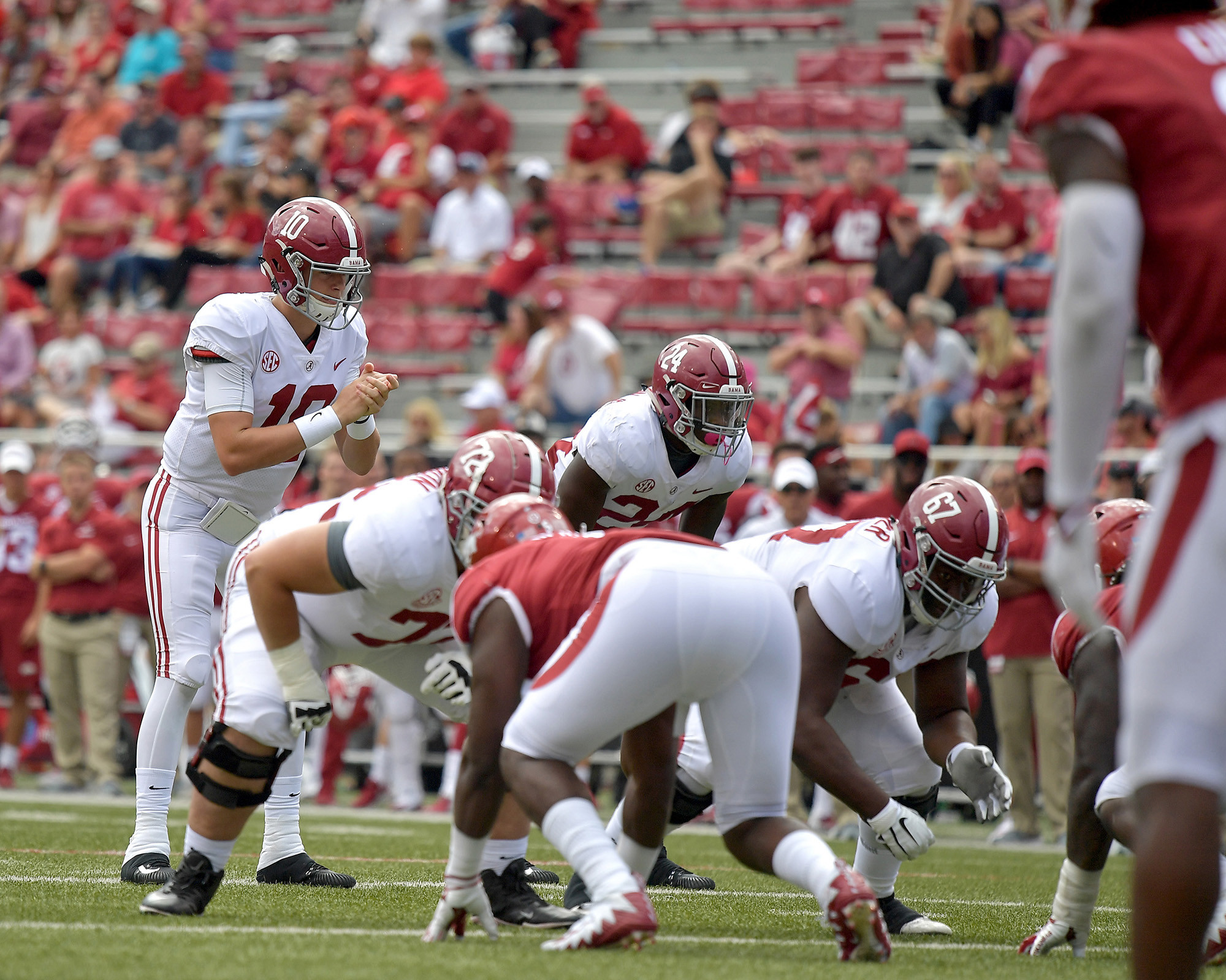 Alabama Crimson Tide quarterback Mac Jones (10) prepares to take the snap in the fourth quarter of the NCAA football game at Razorback Stadium on Oct. 6, 2018, in Fayetteville, Ark. Alabama defeated Arkansas 65-31. (Photo by Lee Walls)
