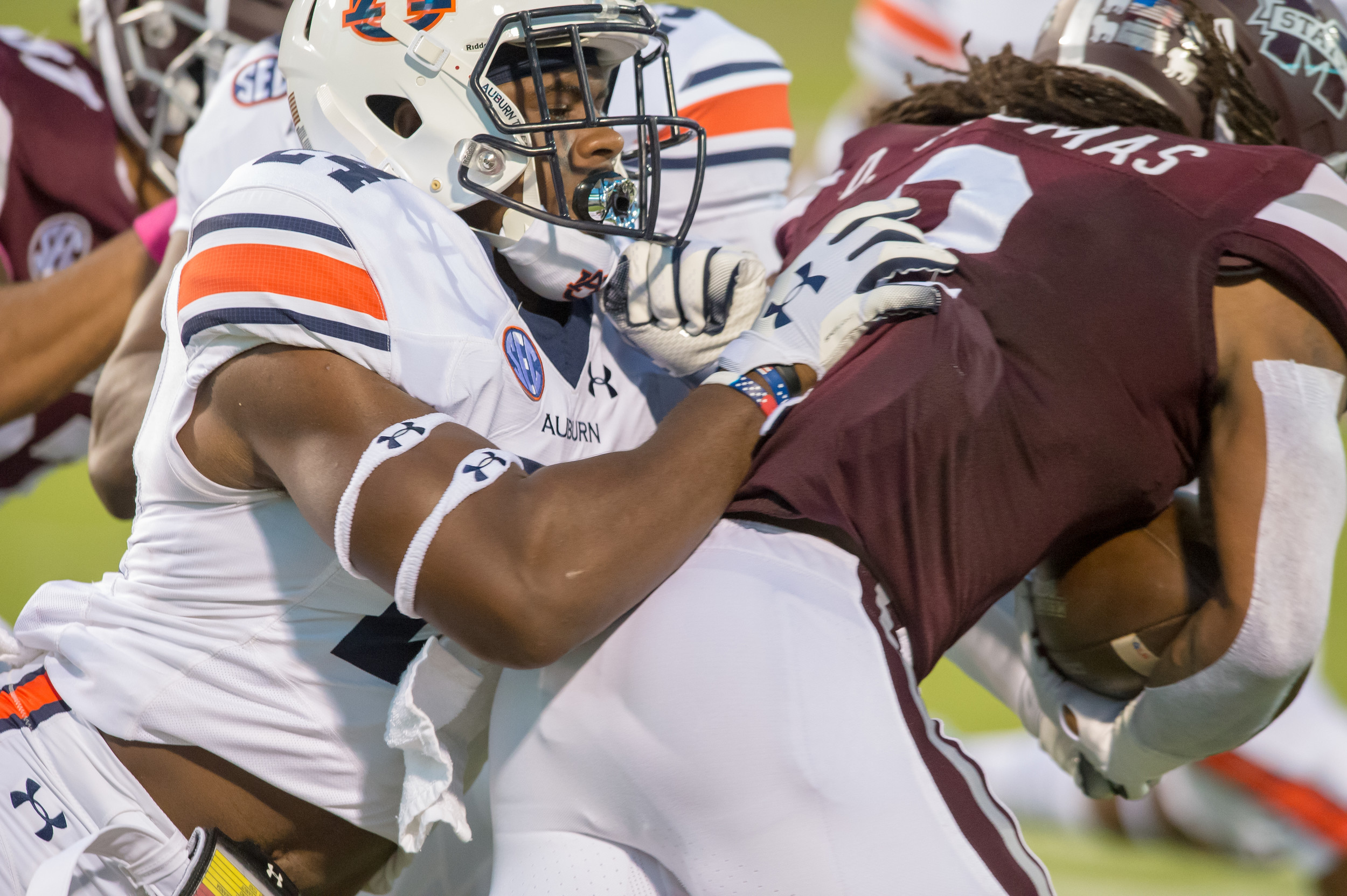 Auburn Tigers defensive back Daniel Thomas (24) tackles Mississippi State Bulldogs cornerback Jamal Peters (2) during the first half of Saturday's game, at Davis Wade Stadium in Starkville, MS. Daily Mountain Eagle -  Jeff Johnsey
