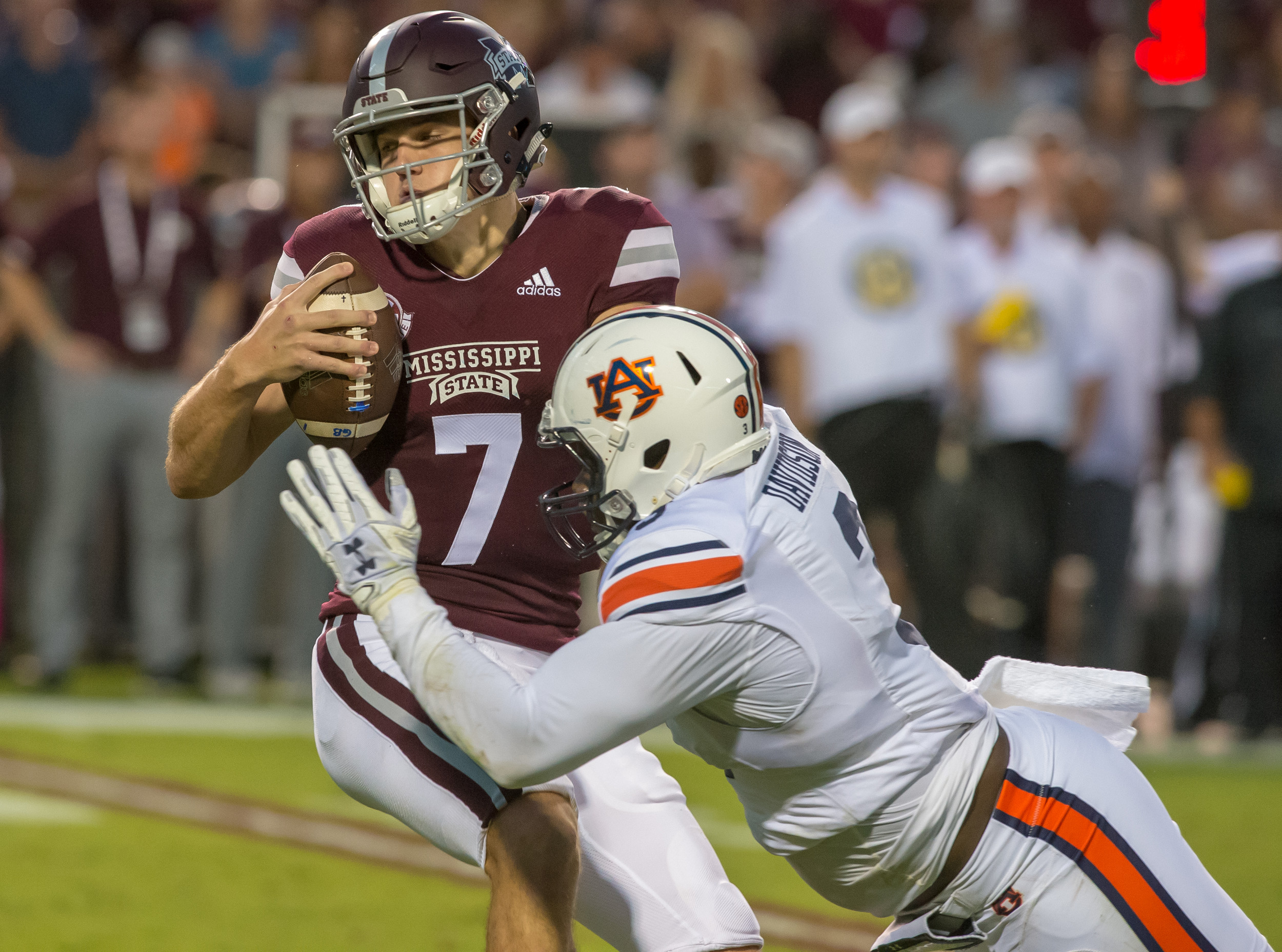 Mississippi State Bulldogs quarterback Nick Fitzgerald (7) escapes the grasp of Auburn Tigers defensive lineman Marlon Davidson (3) during the first half of Saturday's game, at Davis Wade Stadium in Starkville, MS. Daily Mountain Eagle -  Jeff Johnsey