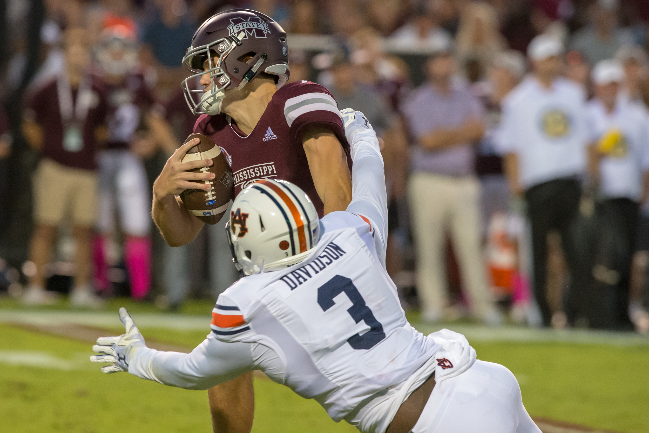 Auburn Tigers defensive lineman Marlon Davidson (3) pressures Mississippi State Bulldogs quarterback Nick Fitzgerald (7) during the first half of Saturday's game, at Davis Wade Stadium in Starkville, MS. Daily Mountain Eagle -  Jeff Johnsey