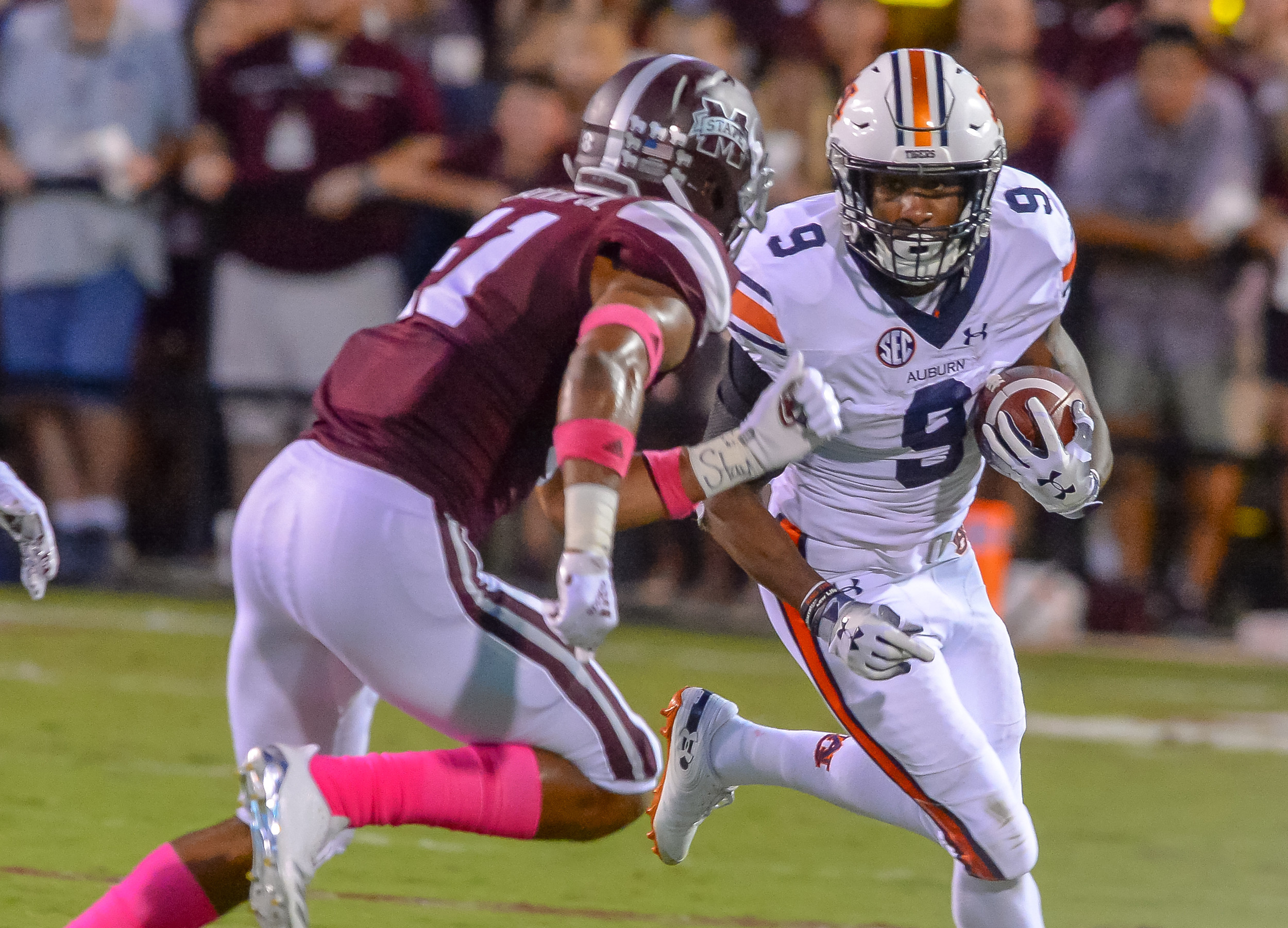 Auburn Tigers running back Kam Martin (9) looks to run  during the first half of Saturday's game, at Davis Wade Stadium in Starkville, MS. Daily Mountain Eagle -  Jeff Johnsey