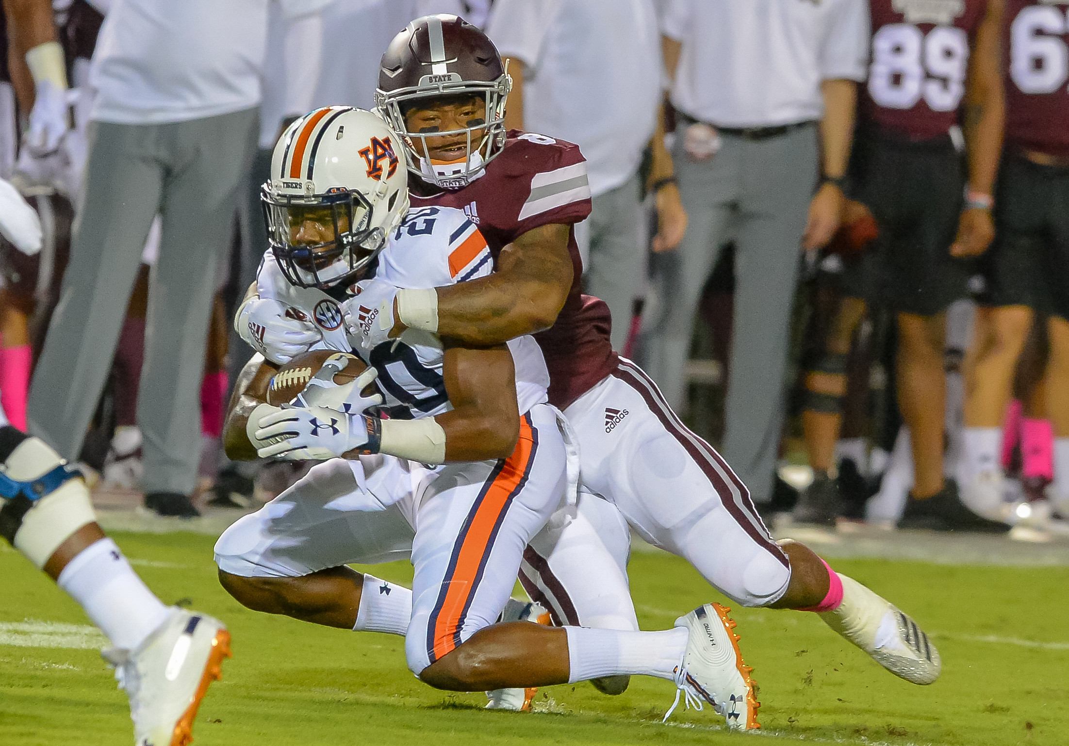 Auburn Tigers defensive back Jeremiah Dinson (20) is brought by Mississippi State Bulldogs running back Kylin Hill (8) after intercepting a pass during the first half of Saturday's game, at Davis Wade Stadium in Starkville, MS. Daily Mountain Eagle -  Jeff Johnsey
