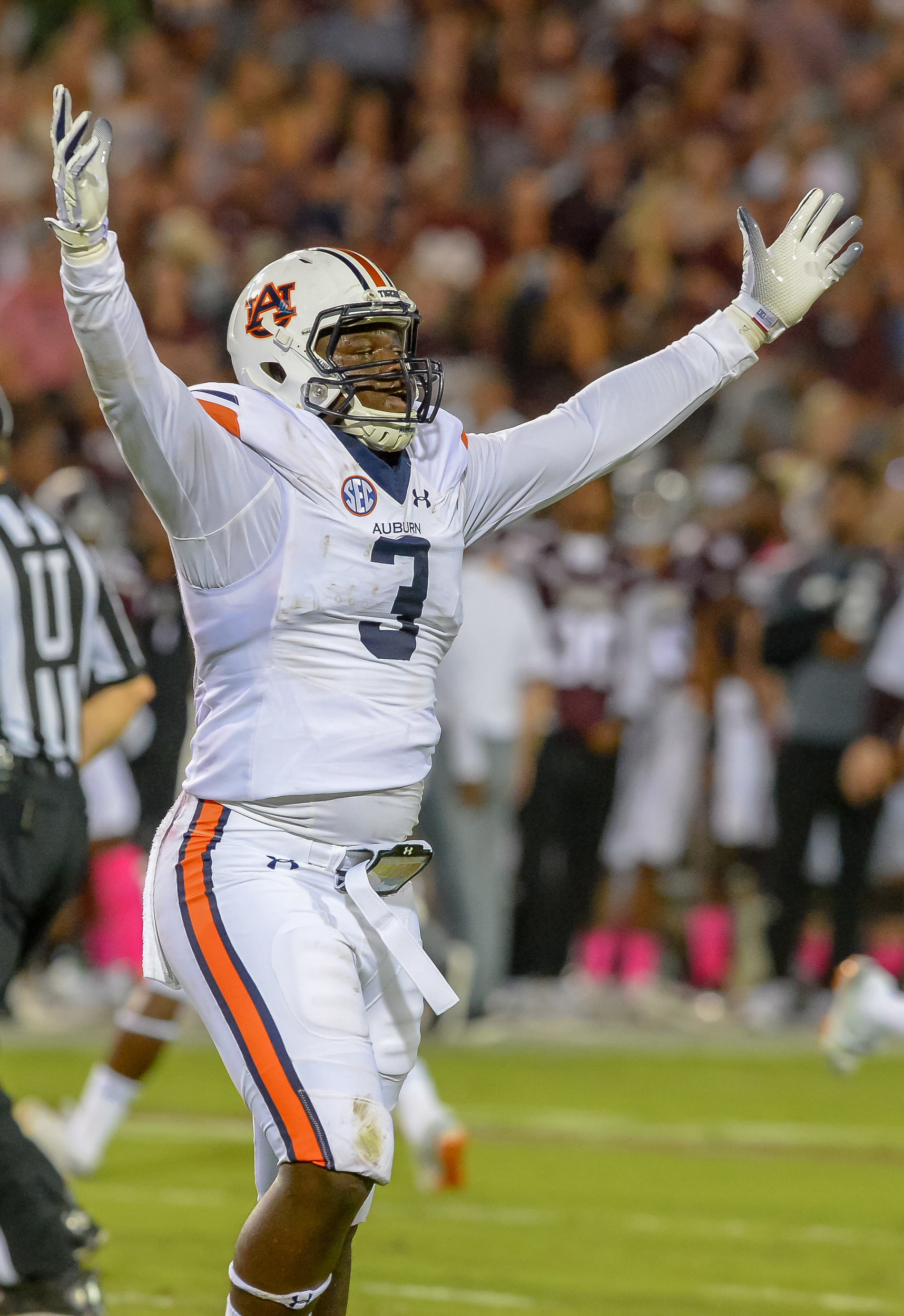 Auburn Tigers defensive lineman Marlon Davidson (3) celebrates after a turnover during the first half of Saturday's game, at Davis Wade Stadium in Starkville, MS. Daily Mountain Eagle -  Jeff Johnsey