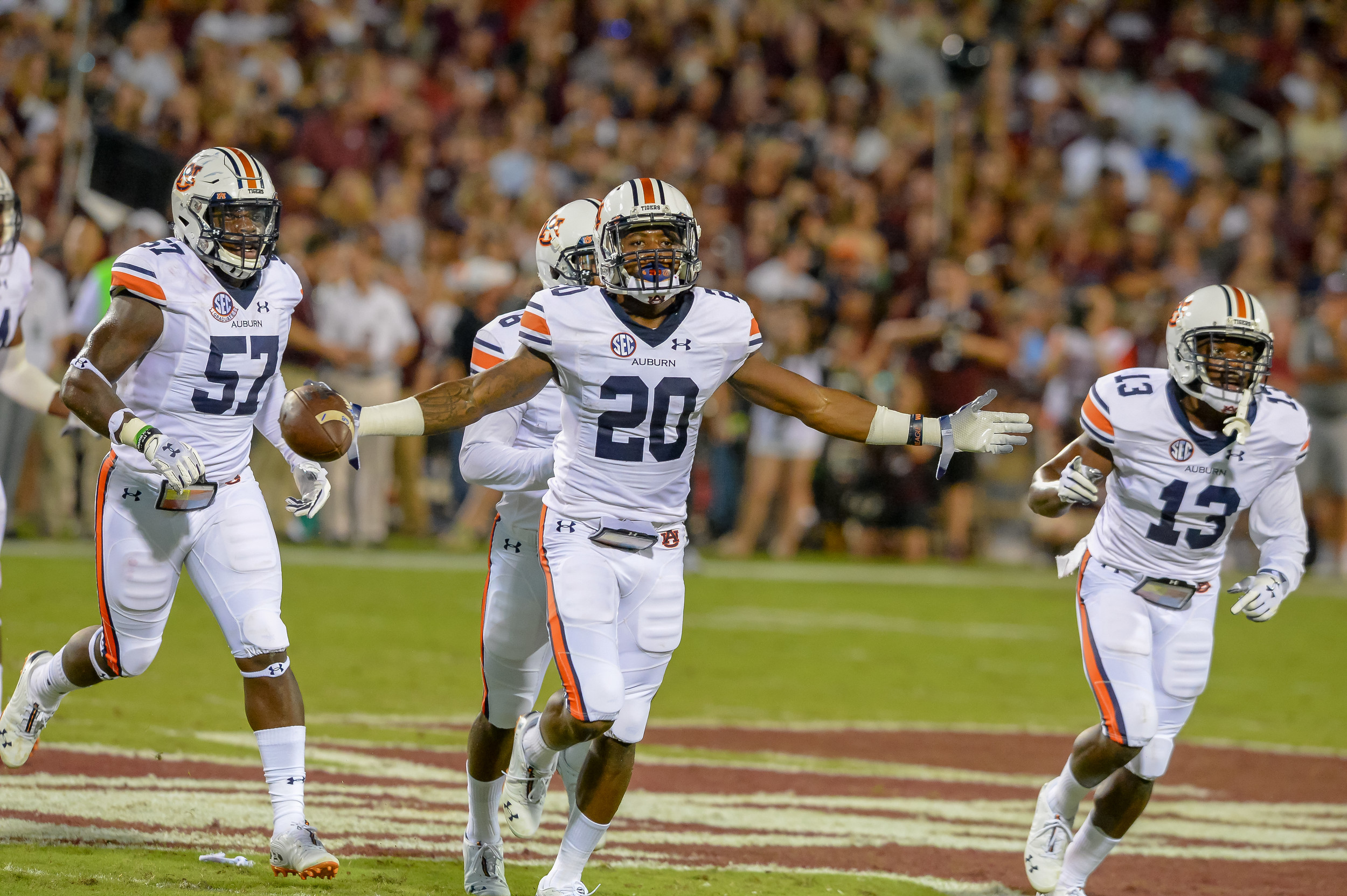Auburn Tigers defensive back Jeremiah Dinson (20) celebrates after intercepting a pass during the first half of Saturday's game, at Davis Wade Stadium in Starkville, MS. Daily Mountain Eagle -  Jeff Johnsey