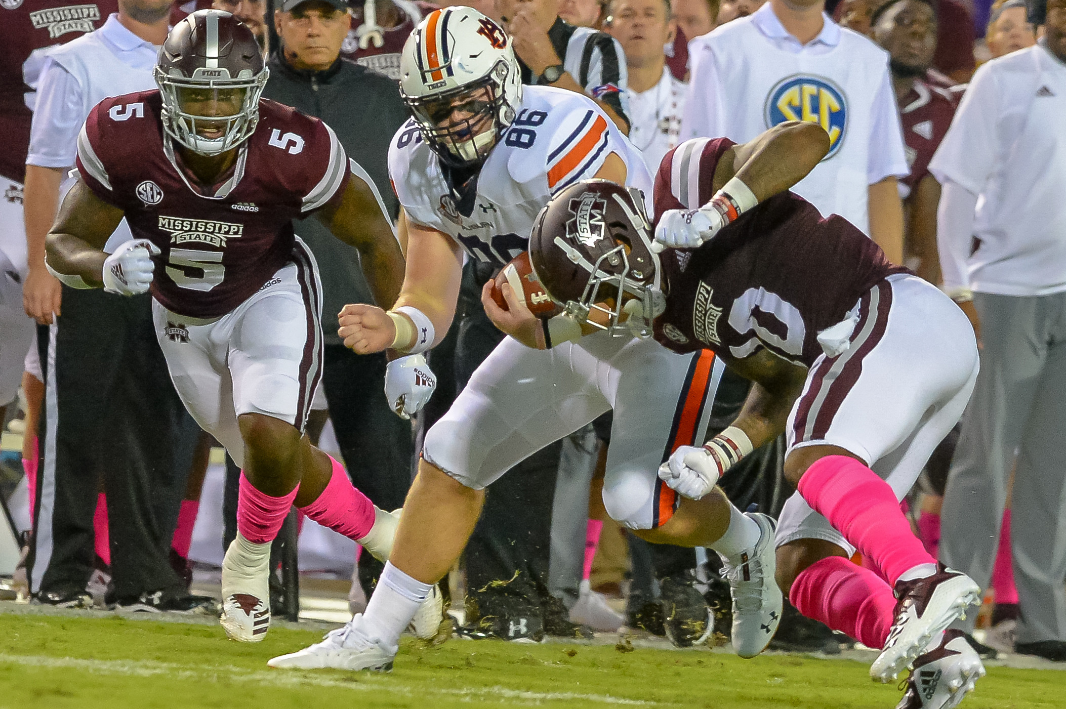 Auburn Tigers tight end Tucker Brown (86) is tackled by Mississippi State Bulldogs linebacker Leo Lewis (10) during the first half of Saturday's game, at Davis Wade Stadium in Starkville, MS. Daily Mountain Eagle -  Jeff Johnsey