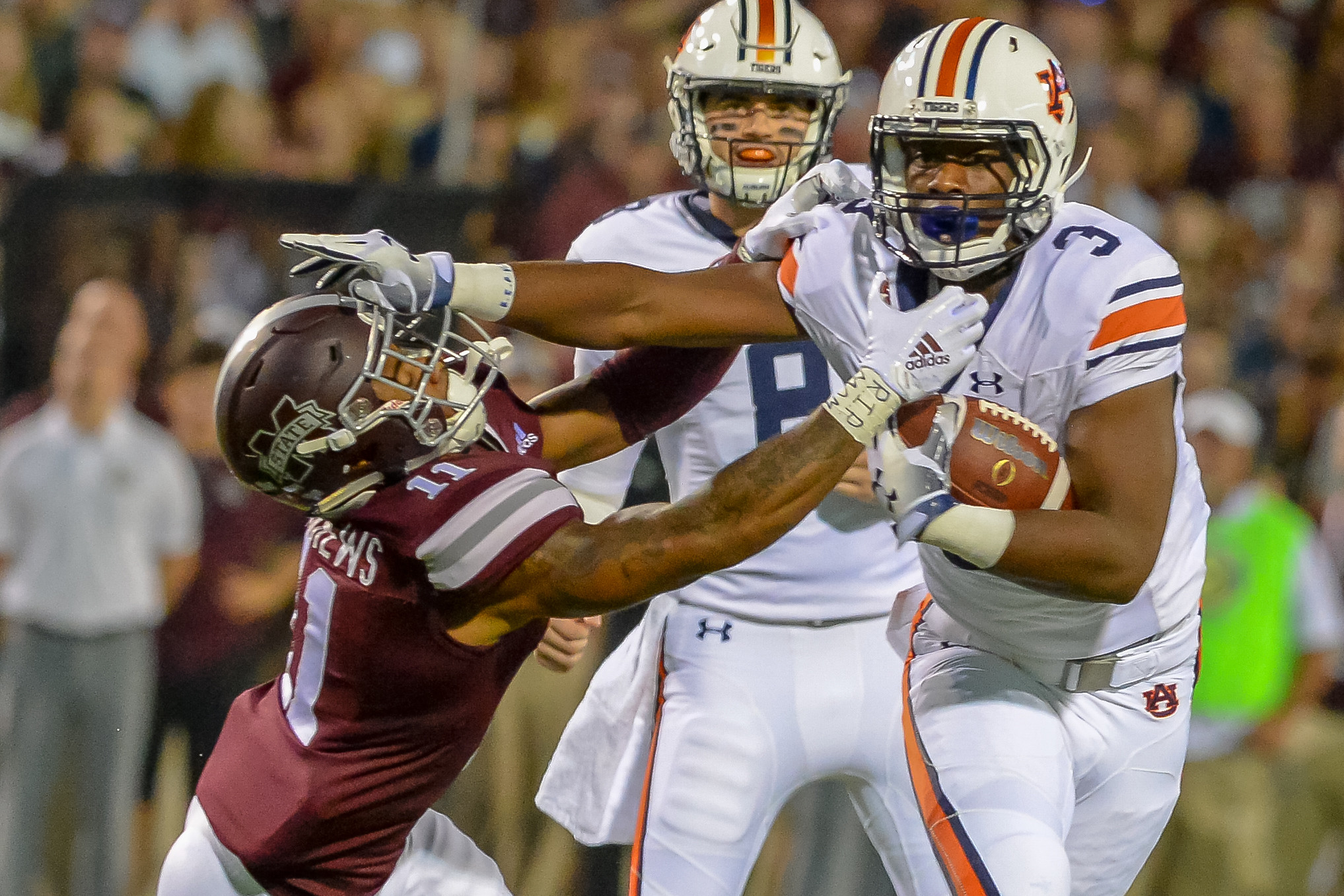 Auburn Tigers running back Asa Martin (20) breaks the tackle of Mississippi State Bulldogs safety Jaquarius Landrews (11) during the first half of Saturday's game, at Davis Wade Stadium in Starkville, MS. Daily Mountain Eagle -  Jeff Johnsey