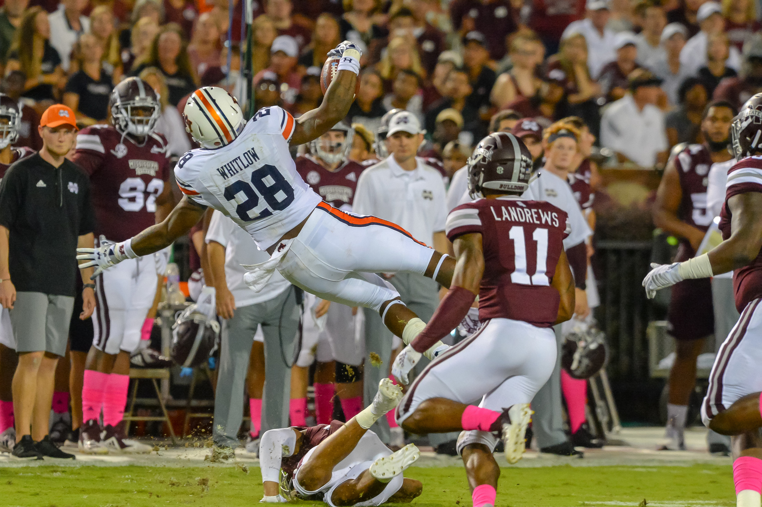 Auburn Tigers running back JaTarvious Whitlow (28) is upended during the first half of Saturday's game, at Davis Wade Stadium in Starkville, MS. Daily Mountain Eagle -  Jeff Johnsey