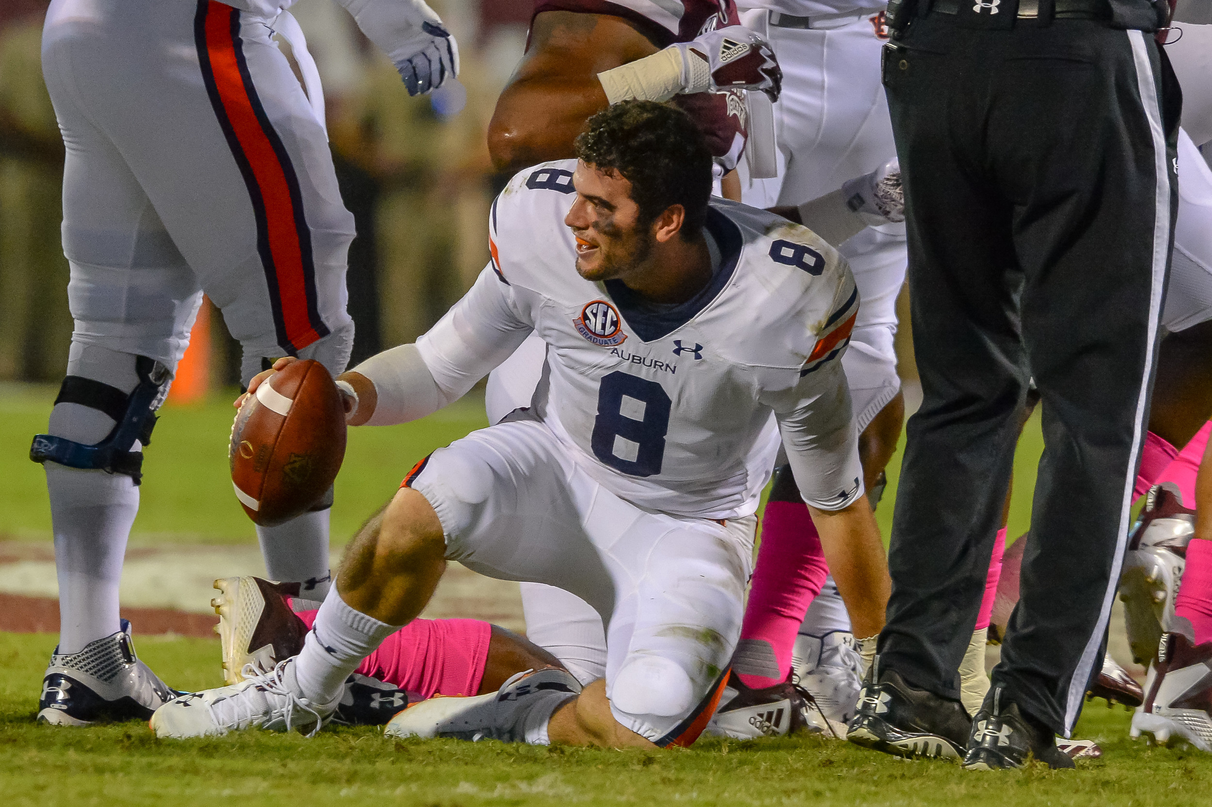 Auburn Tigers quarterback Jarrett Stidham (8) loses his helmet during the first half of Saturday's game, at Davis Wade Stadium in Starkville, MS. Daily Mountain Eagle -  Jeff Johnsey