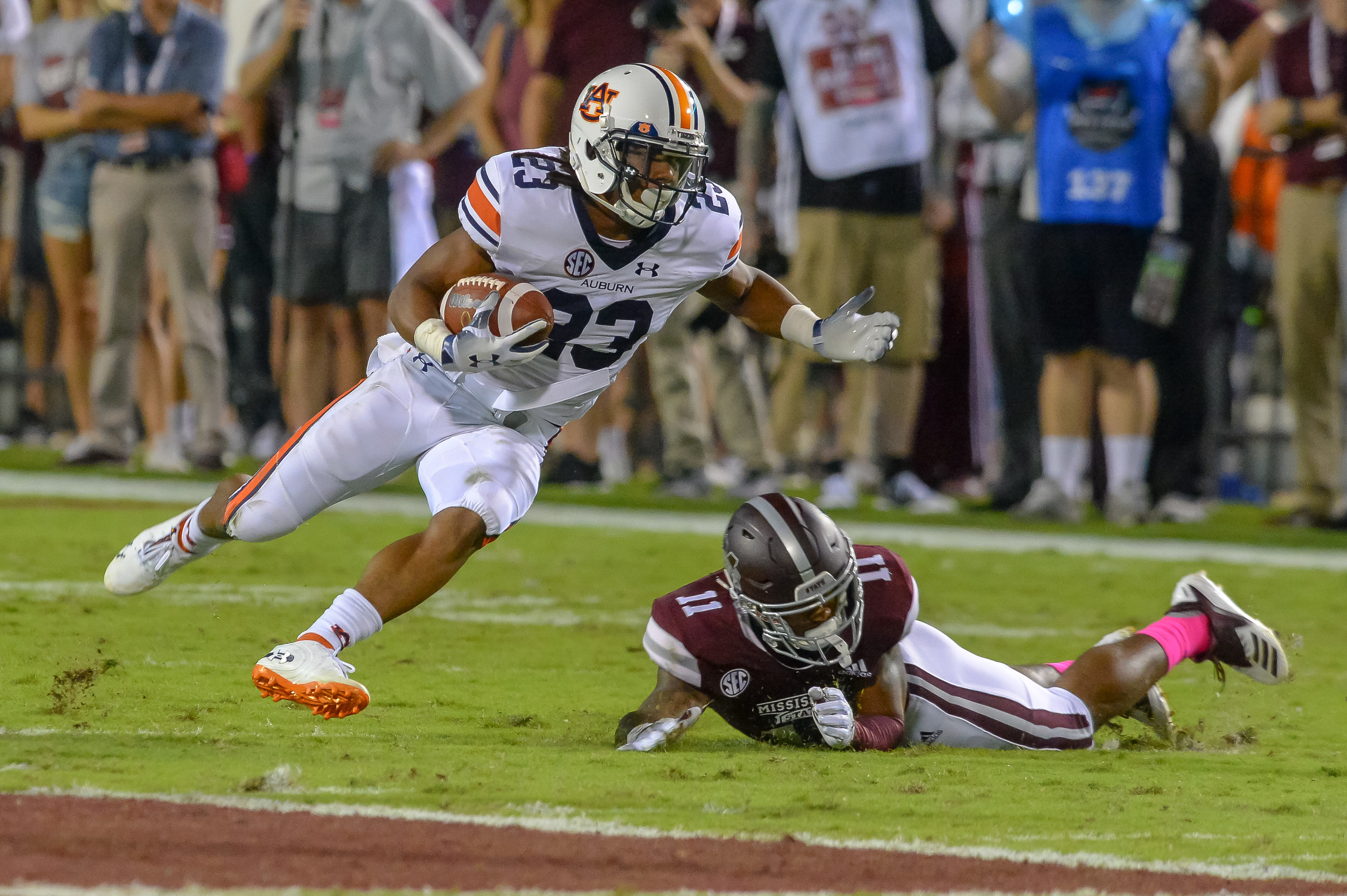 Auburn Tigers wide receiver Ryan Davis (23) runs past the tackle of Mississippi State Bulldogs safety Jaquarius Landrews (11) during the first half of Saturday's game, at Davis Wade Stadium in Starkville, MS. Daily Mountain Eagle -  Jeff Johnsey