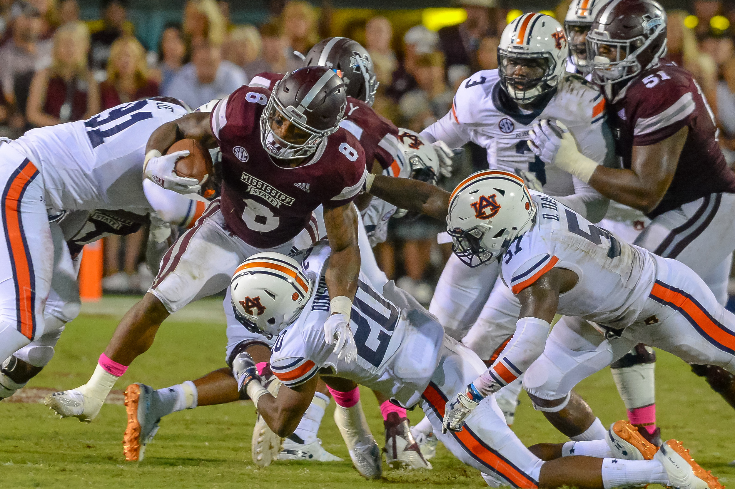 Mississippi State Bulldogs running back Kylin Hill (8) is tackled by Auburn Tigers defensive back Jeremiah Dinson (20) during the second half of Saturday's game, at Davis Wade Stadium in Starkville, MS. Daily Mountain Eagle -  Jeff Johnsey