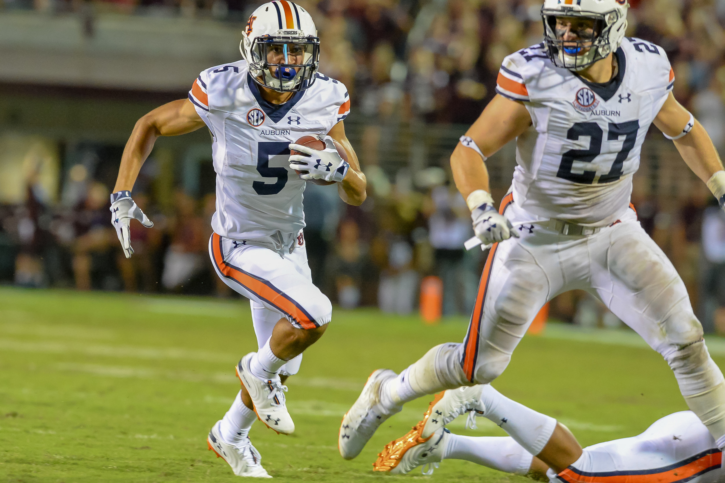 Auburn Tigers wide receiver Anthony Schwartz (5) runs behind the blocking of fullback Chandler Cox during the second half of Saturday's game, at Davis Wade Stadium in Starkville, MS. Daily Mountain Eagle -  Jeff Johnsey