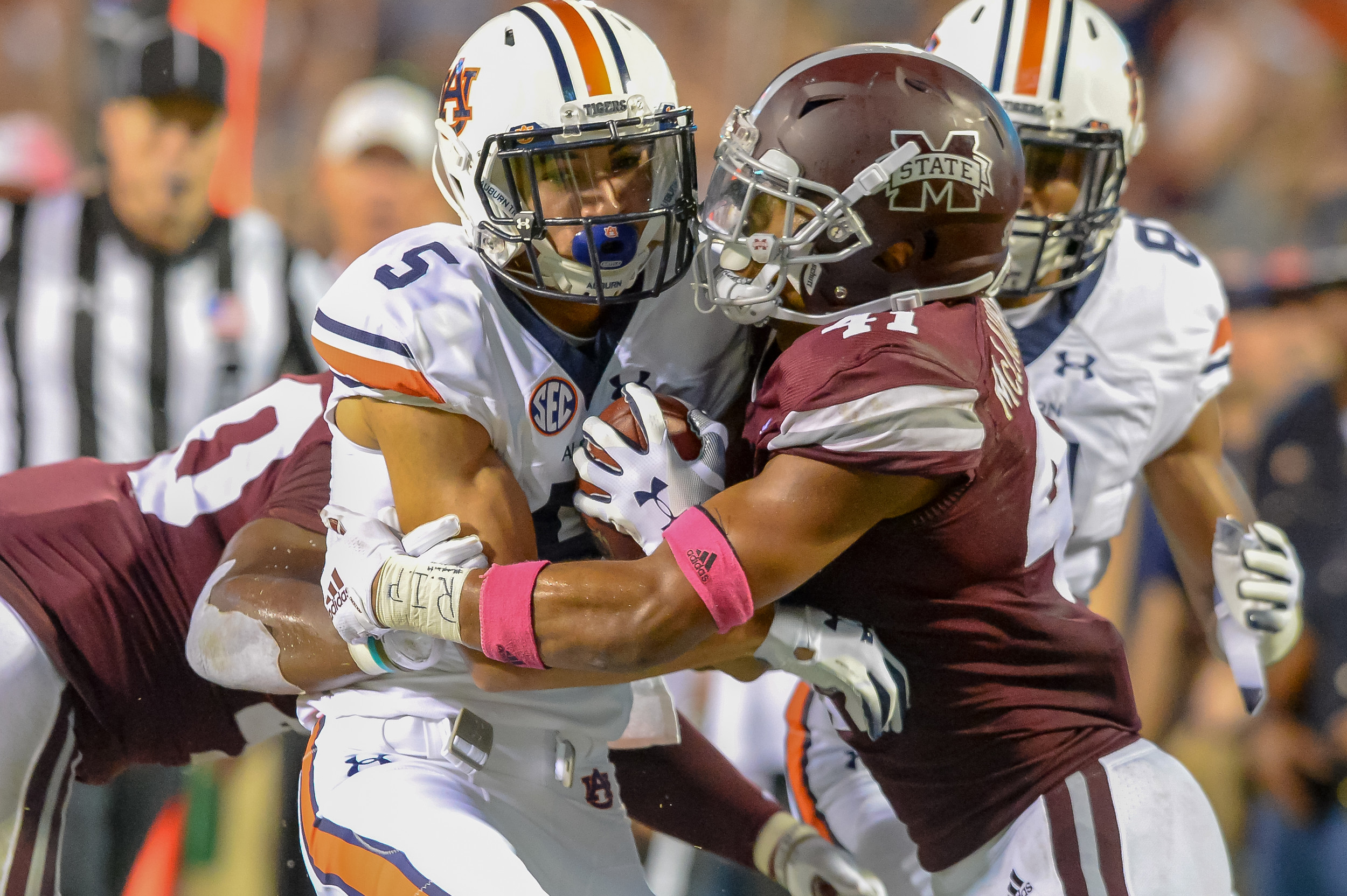 Auburn Tigers wide receiver Anthony Schwartz (5) is tackled by Mississippi State Bulldogs safety Mark McLaurin (41) during the second half of Saturday's game, at Davis Wade Stadium in Starkville, MS. Daily Mountain Eagle -  Jeff Johnsey