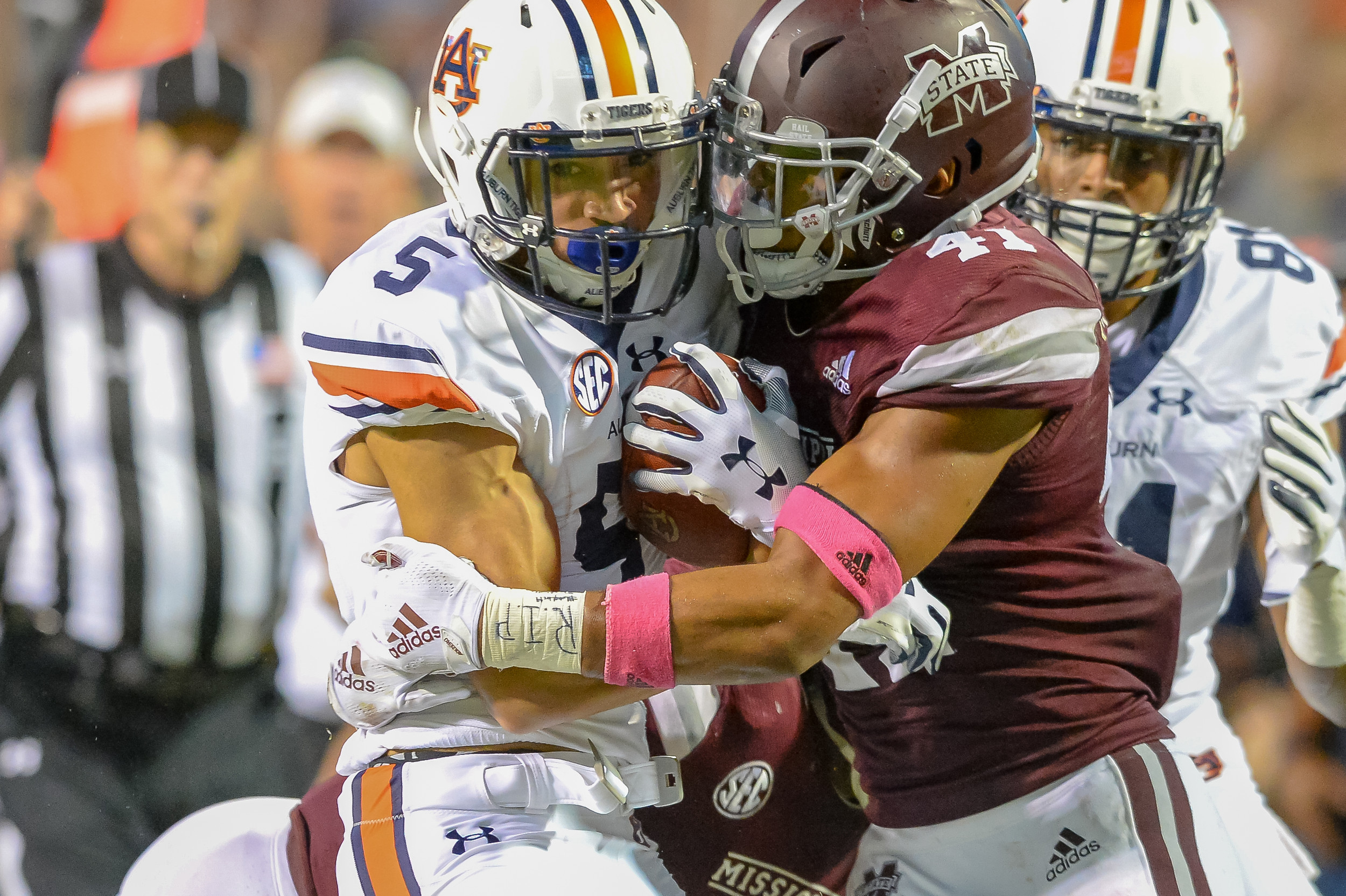 Auburn Tigers wide receiver Anthony Schwartz (5) is brought down by Mississippi State Bulldogs safety Mark McLaurin (41) during the second half of Saturday's game, at Davis Wade Stadium in Starkville, MS. Daily Mountain Eagle -  Jeff Johnsey