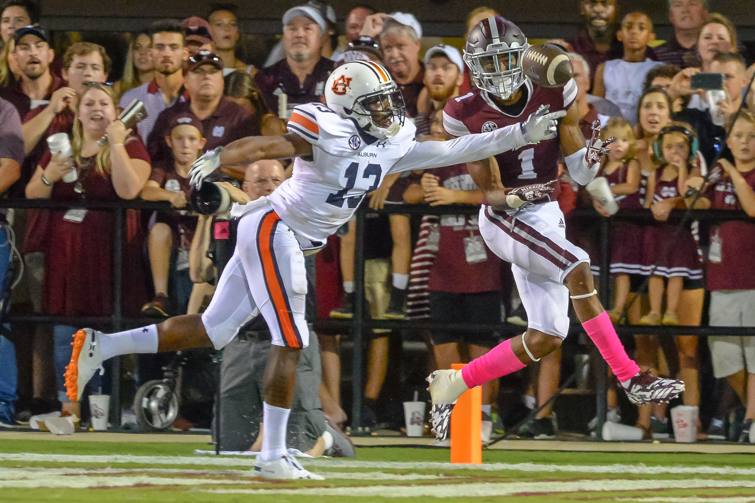 Auburn Tigers defensive back Javaris Davis (13) breaks up a pass intended for Mississippi State Bulldogs wide receiver Stephen Guidry (1) during the second half of Saturday's game, at Davis Wade Stadium in Starkville, MS. Daily Mountain Eagle -  Jeff Johnsey