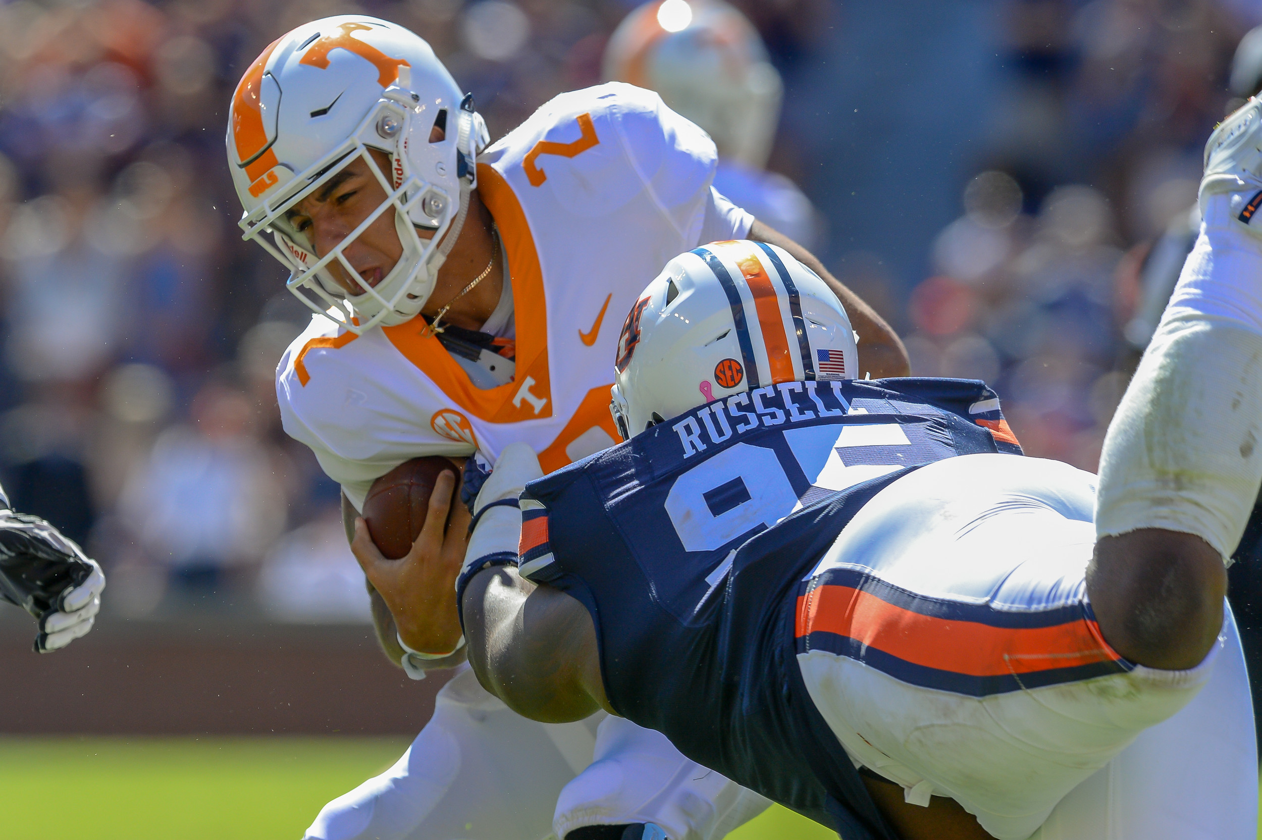 Auburn Tigers defensive lineman Dontavius Russell (95) pressures Tennessee Volunteers quarterback Jarrett Guarantano (2) during the second half of Saturday's game, at Jordan-Hare Stadium in Auburn, AL. Daily Mountain Eagle -  Jeff Johnsey