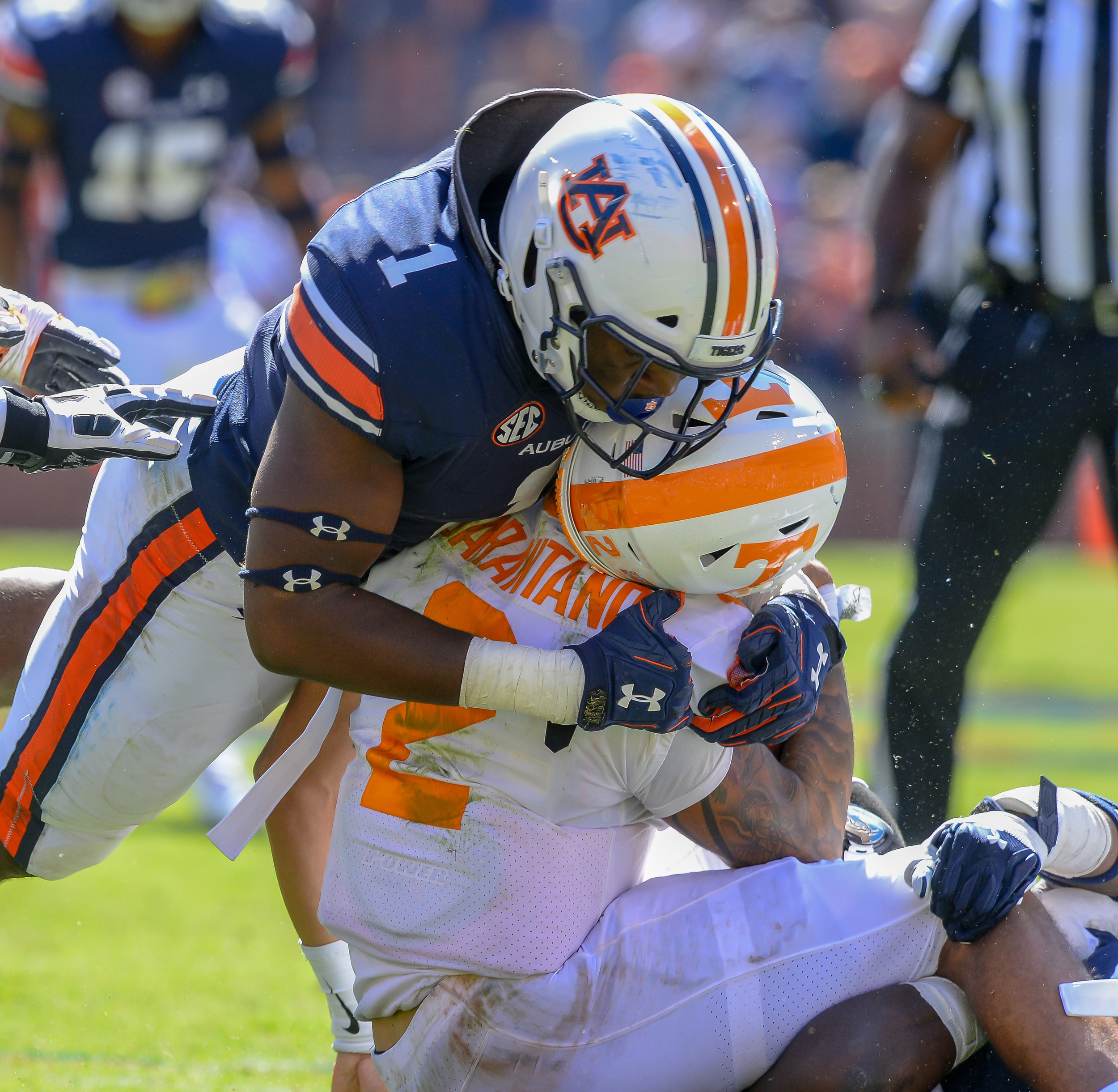 Auburn Tigers linebacker Big Kat Bryant (1) sacks Tennessee Volunteers quarterback Jarrett Guarantano (2) during the second half of Saturday's game, at Jordan-Hare Stadium in Auburn, AL. Daily Mountain Eagle -  Jeff Johnsey