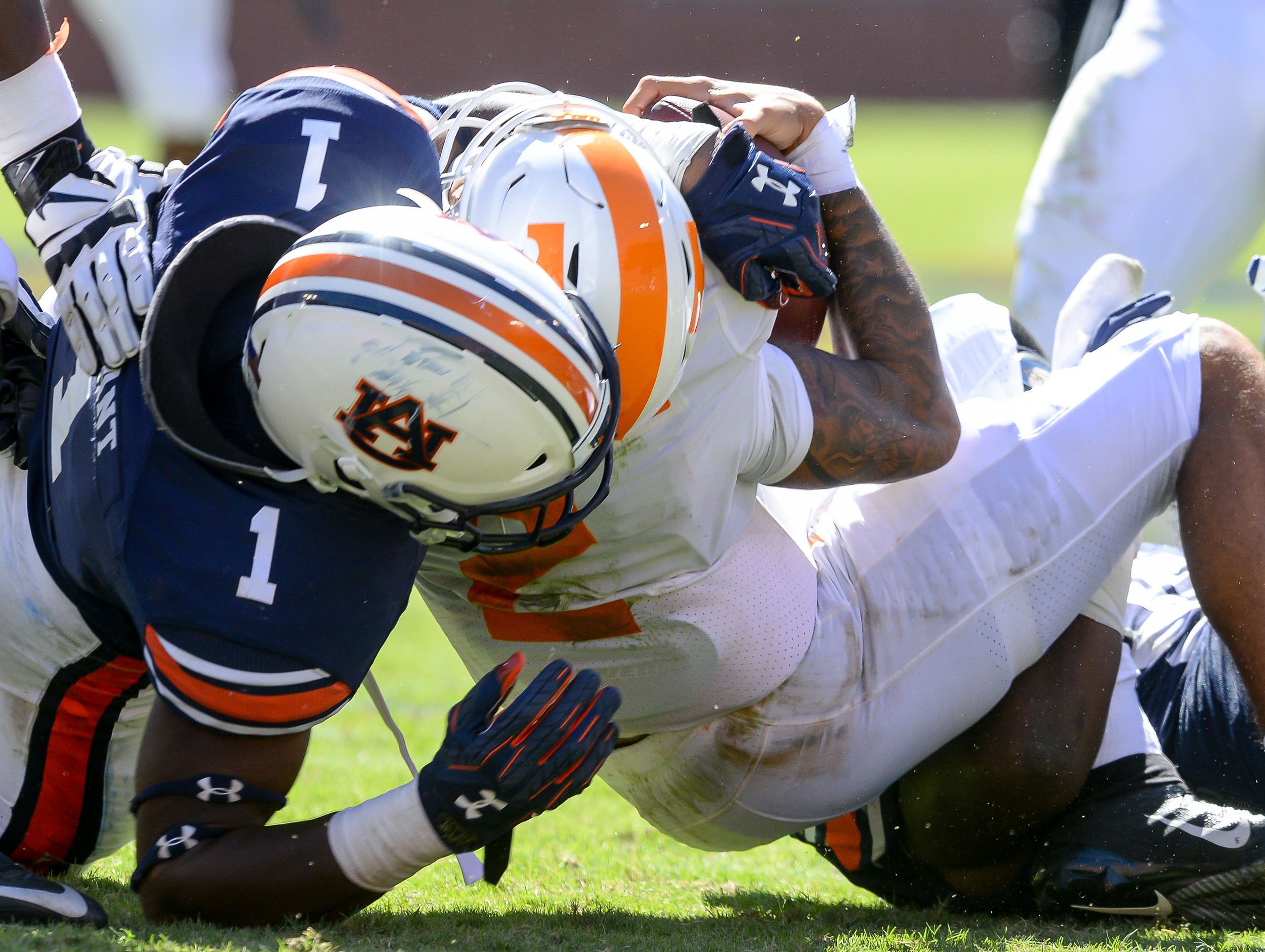 Auburn Tigers linebacker Big Kat Bryant (1) tackles Tennessee Volunteers quarterback Jarrett Guarantano (2) during the second half of Saturday's game, at Jordan-Hare Stadium in Auburn, AL. Daily Mountain Eagle -  Jeff Johnsey
