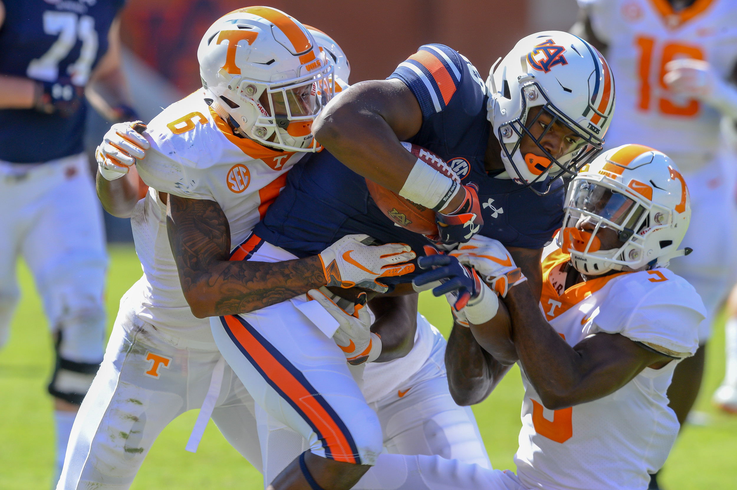 Tennessee Volunteers defensive back Alontae Taylor (6) and defensive back Marquill Osborne (3) tackle Auburn Tigers wide receiver Seth Williams (18) during the second half of Saturday's game, at Jordan-Hare Stadium in Auburn, AL. Daily Mountain Eagle -  Jeff Johnsey