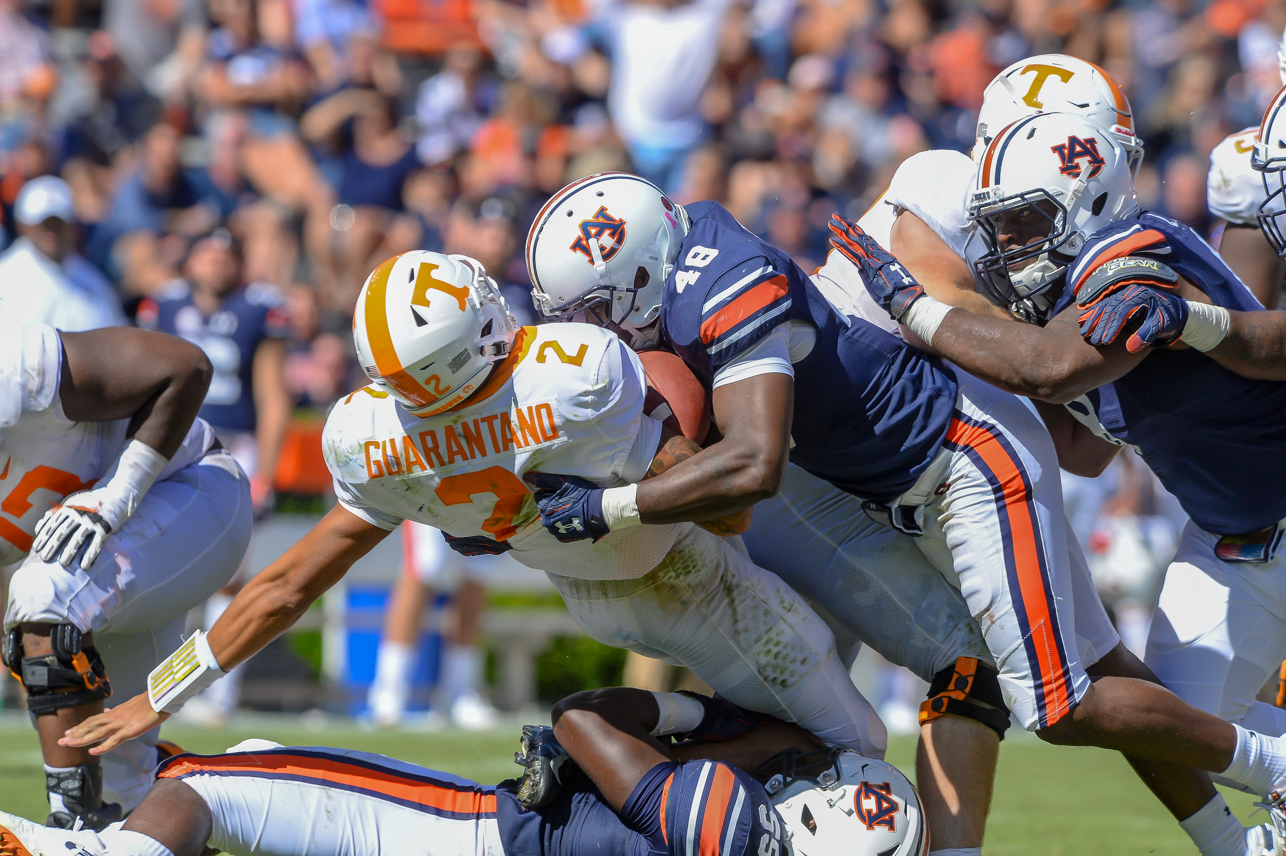 Tennessee Volunteers quarterback Jarrett Guarantano (2) is brought down by Auburn Tigers linebacker T.D. Moultry (55) and linebacker Montavious Atkinson (48) during the second half of Saturday's game, at Jordan-Hare Stadium in Auburn, AL. Daily Mountain Eagle -  Jeff Johnsey