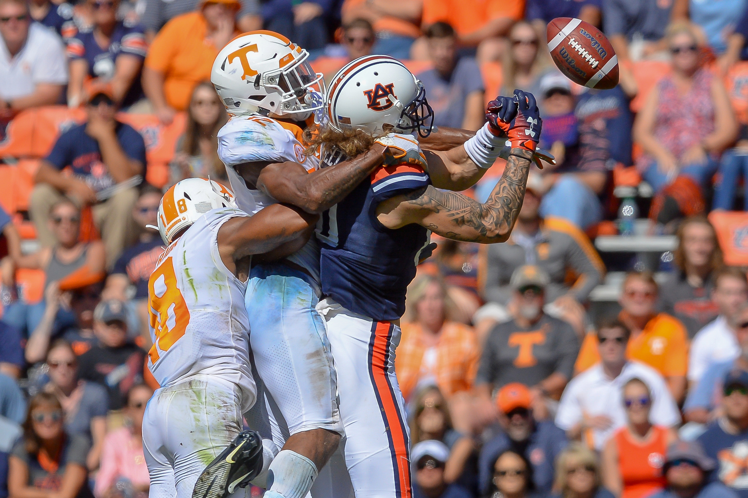 Tennessee Volunteers defensive back Shawn Shamburger (12) breaks up a pass intended for Auburn Tigers tight end Sal Cannella (80) during the second half of Saturday's game, at Jordan-Hare Stadium in Auburn, AL. Daily Mountain Eagle -  Jeff Johnsey