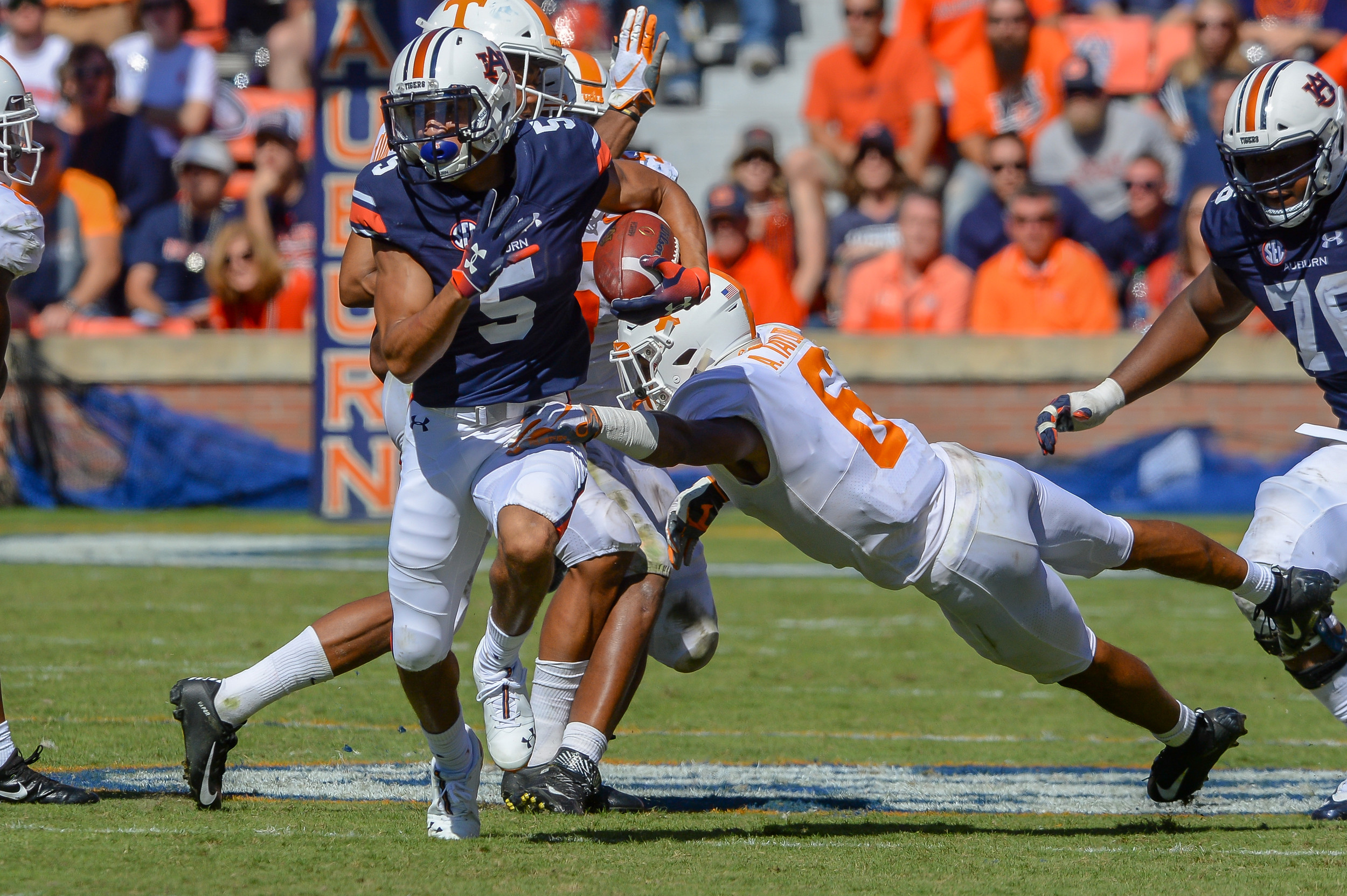 Auburn Tigers wide receiver Anthony Schwartz (5) runs past Tennessee Volunteers defensive back Alontae Taylor (6) during the second half of Saturday's game, at Jordan-Hare Stadium in Auburn, AL. Daily Mountain Eagle -  Jeff Johnsey