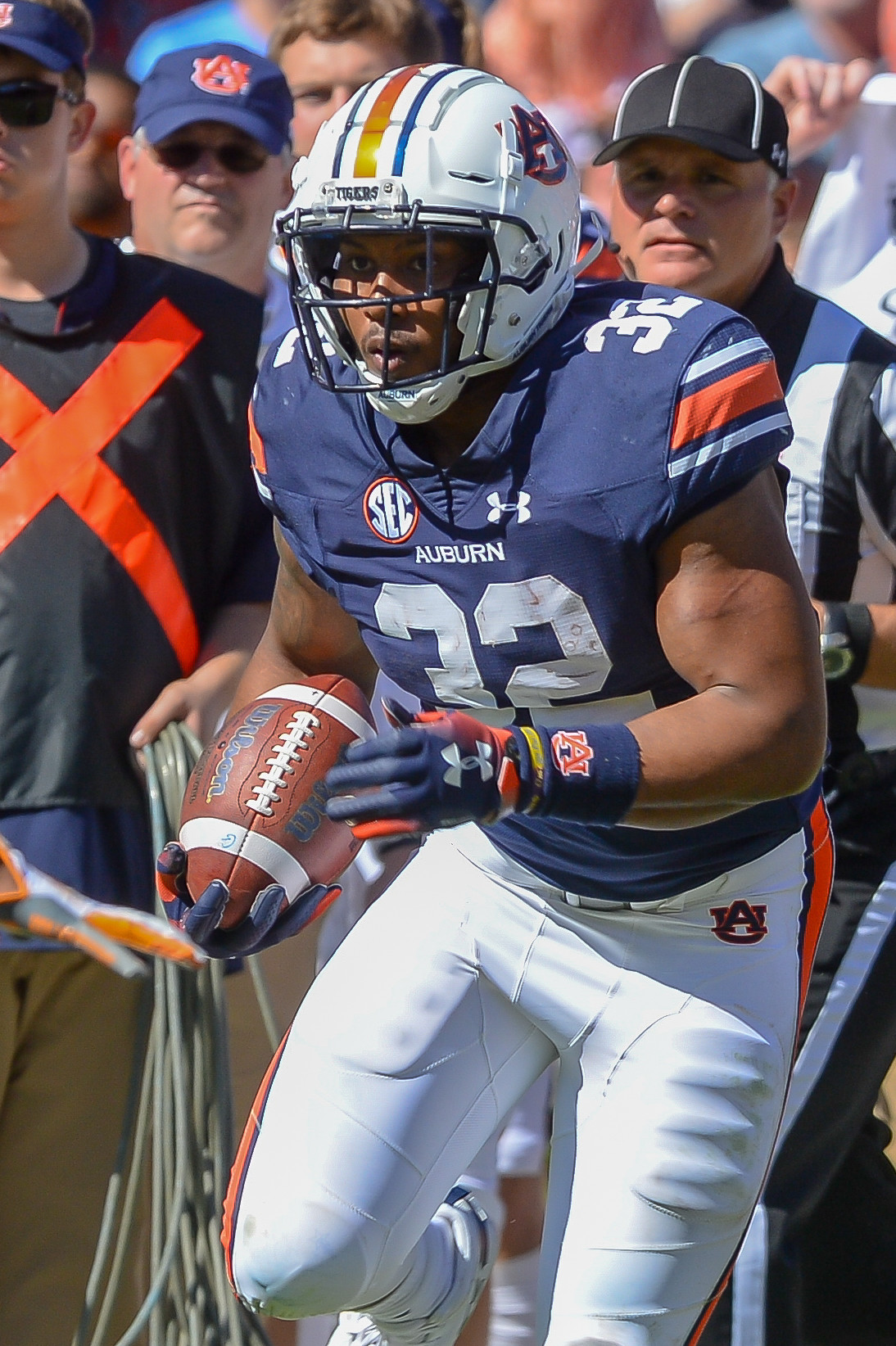 Auburn Tigers running back Malik Miller (32) runs during the second half of Saturday's game, at Jordan-Hare Stadium in Auburn, AL. Daily Mountain Eagle -  Jeff Johnsey