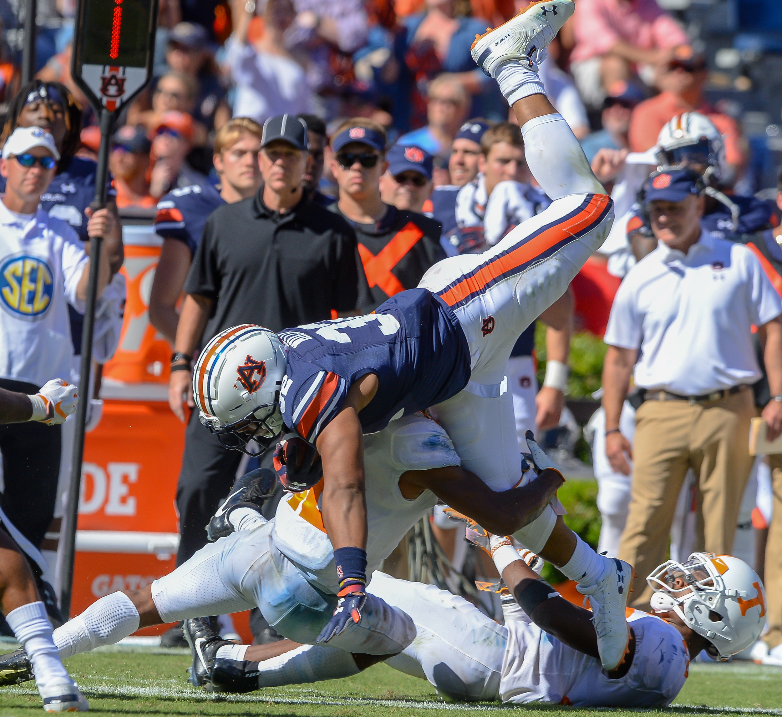 Tennessee Volunteers defensive back Shawn Shamburger (12) upends Auburn Tigers running back Malik Miller (32) during the second half of Saturday's game, at Jordan-Hare Stadium in Auburn, AL. Daily Mountain Eagle -  Jeff Johnsey