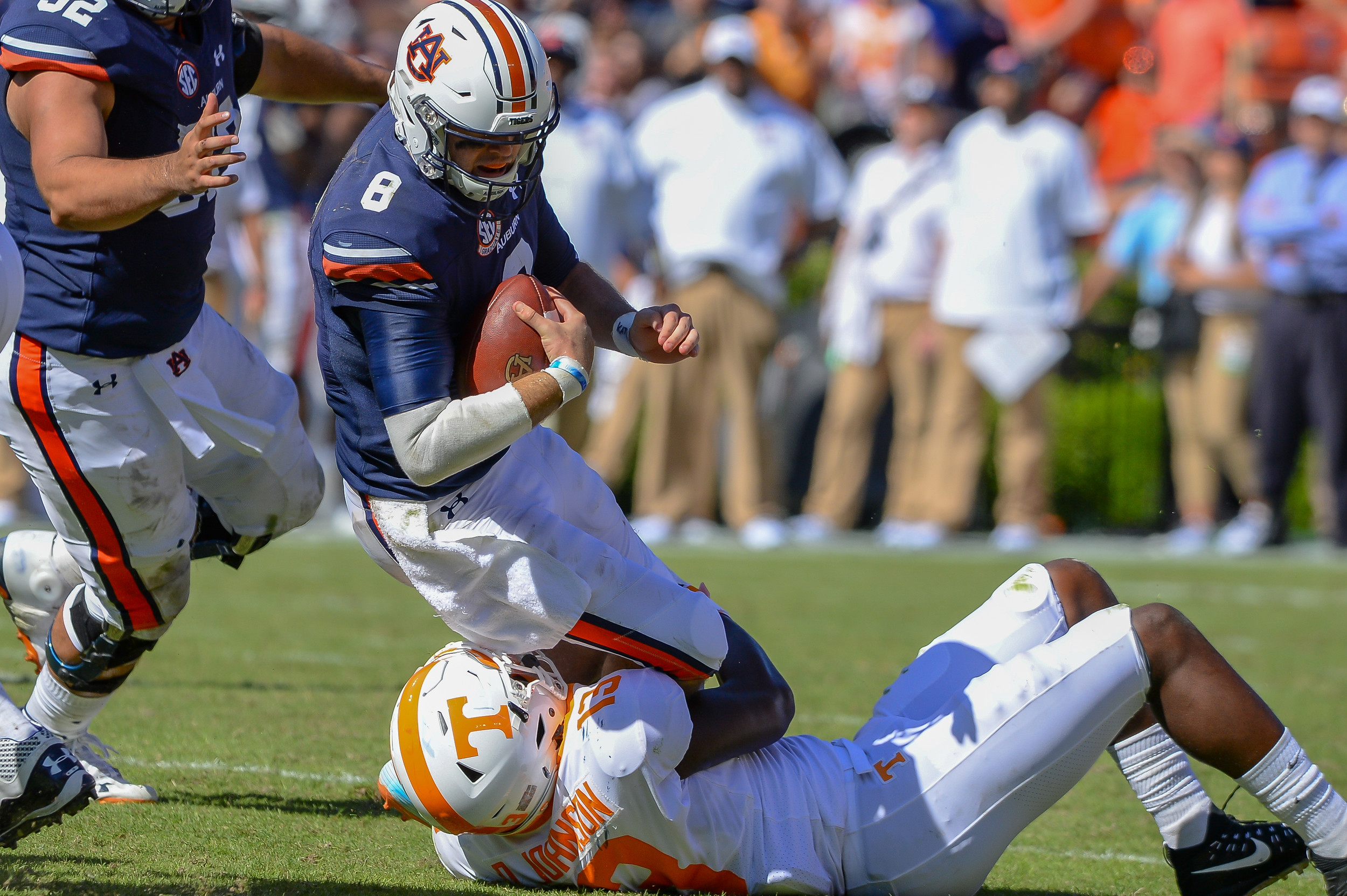 Auburn Tigers quarterback Jarrett Stidham (8) is brought down by Tennessee Volunteers linebacker Deandre Johnson (13) during the second half of Saturday's game, at Jordan-Hare Stadium in Auburn, AL. Daily Mountain Eagle -  Jeff Johnsey
