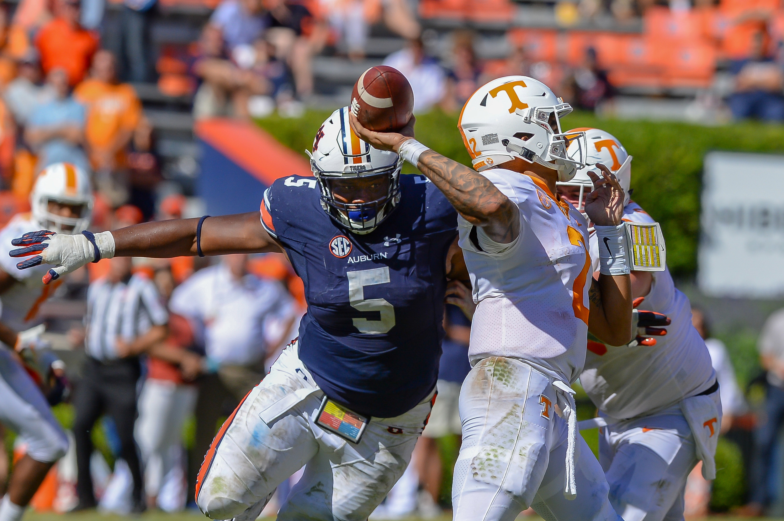 Auburn Tigers defensive lineman Derrick Brown (5) pressures Tennessee Volunteers quarterback Jarrett Guarantano (2) during the second half of Saturday's game, at Jordan-Hare Stadium in Auburn, AL. Daily Mountain Eagle -  Jeff Johnsey