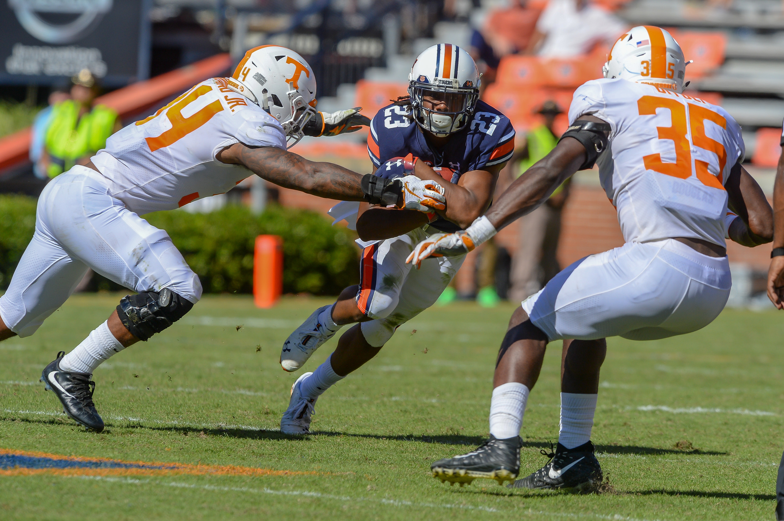 Tennessee Volunteers linebacker Darrin Kirkland Jr. (34) and linebacker Daniel Bituli (35) converge on Auburn Tigers wide receiver Ryan Davis (23) during the second half of Saturday's game, at Jordan-Hare Stadium in Auburn, AL. Daily Mountain Eagle -  Jeff Johnsey