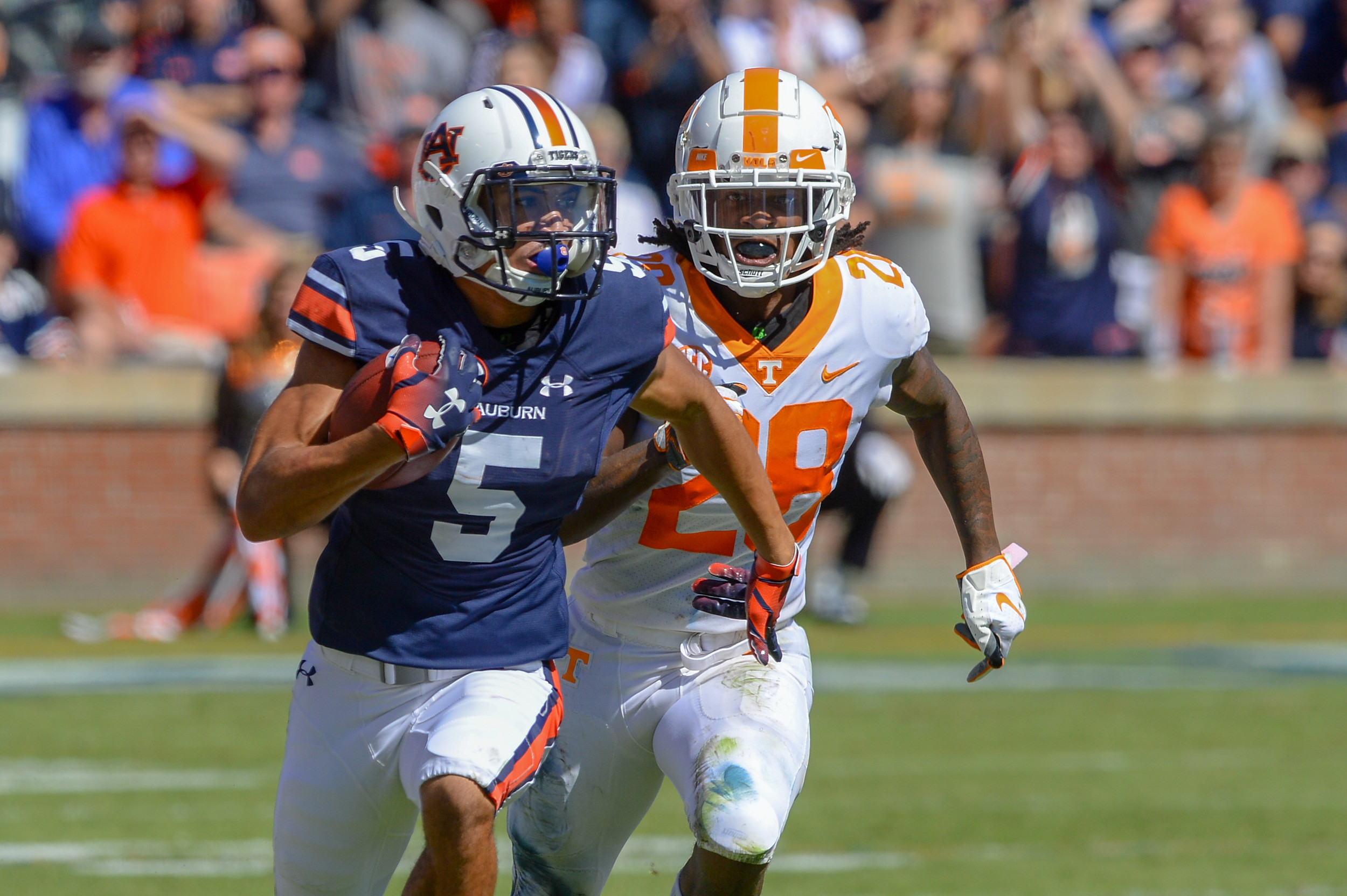 Auburn Tigers wide receiver Anthony Schwartz (5)out runs Tennessee Volunteers defensive back Baylen Buchanan (28) on the way to a 76 yard touchdown during the first half of Saturday's game, at Jordan-Hare Stadium in Auburn, AL. Daily Mountain Eagle -  Jeff Johnsey