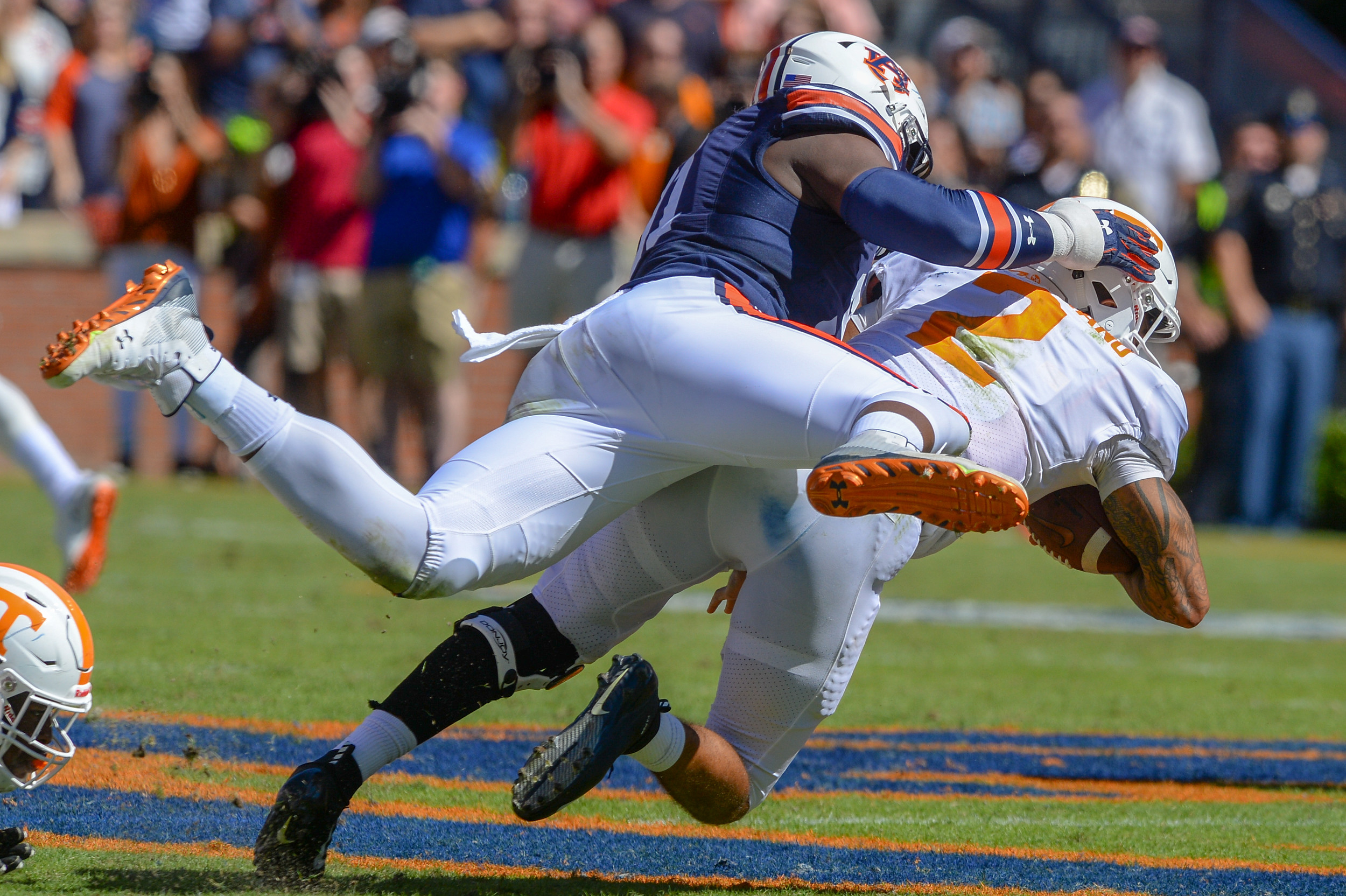 Auburn Tigers defensive lineman Nick Coe (91) sacks Tennessee Volunteers quarterback Jarrett Guarantano (2) during the first half of Saturday's game, at Jordan-Hare Stadium in Auburn, AL. Daily Mountain Eagle -  Jeff Johnsey