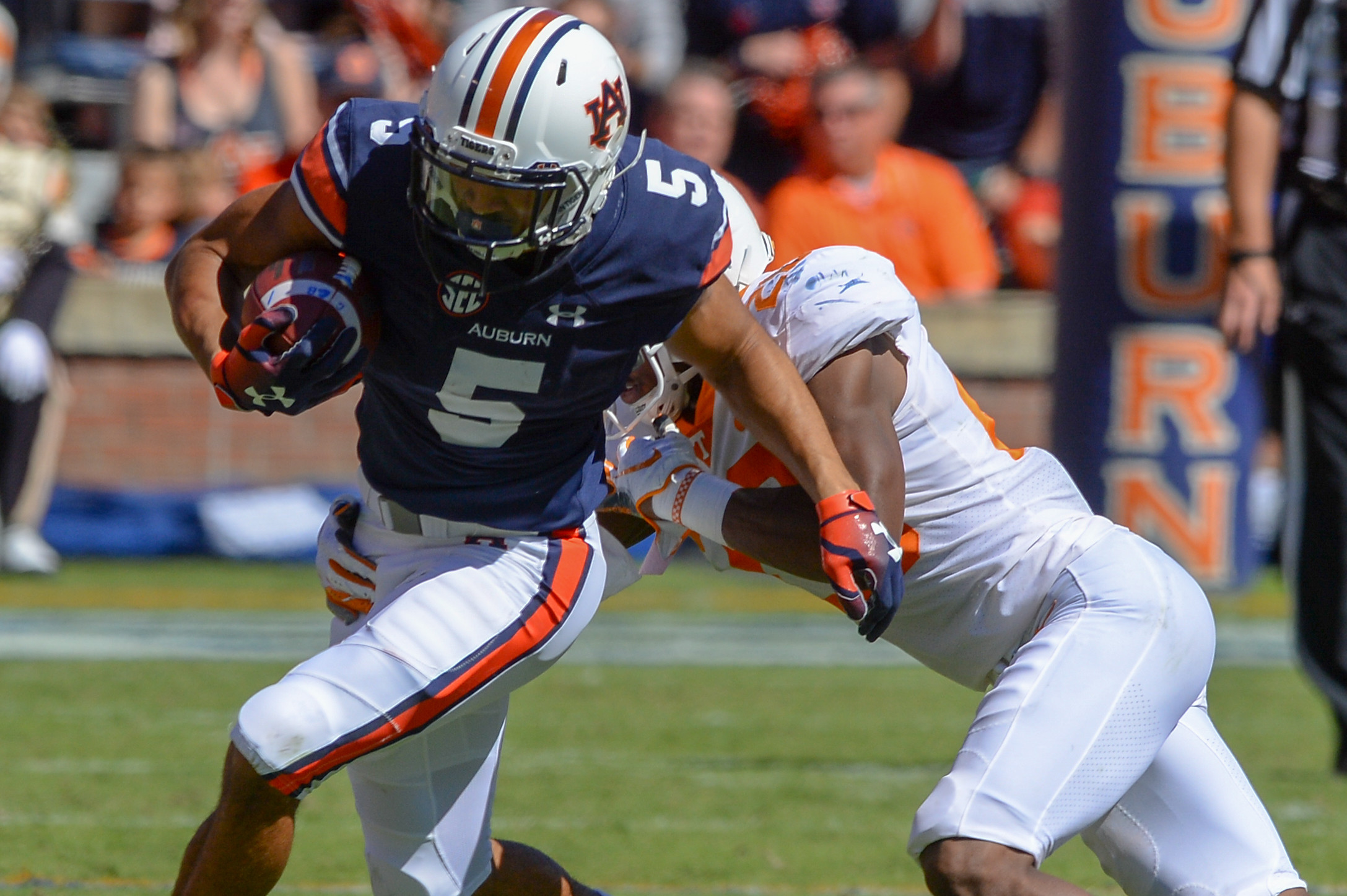 Auburn Tigers wide receiver Anthony Schwartz (5) breaks a tackle by Tennessee Volunteers defensive back Bryce Thompson (20) during the first half of Saturday's game, at Jordan-Hare Stadium in Auburn, AL. Daily Mountain Eagle -  Jeff Johnsey