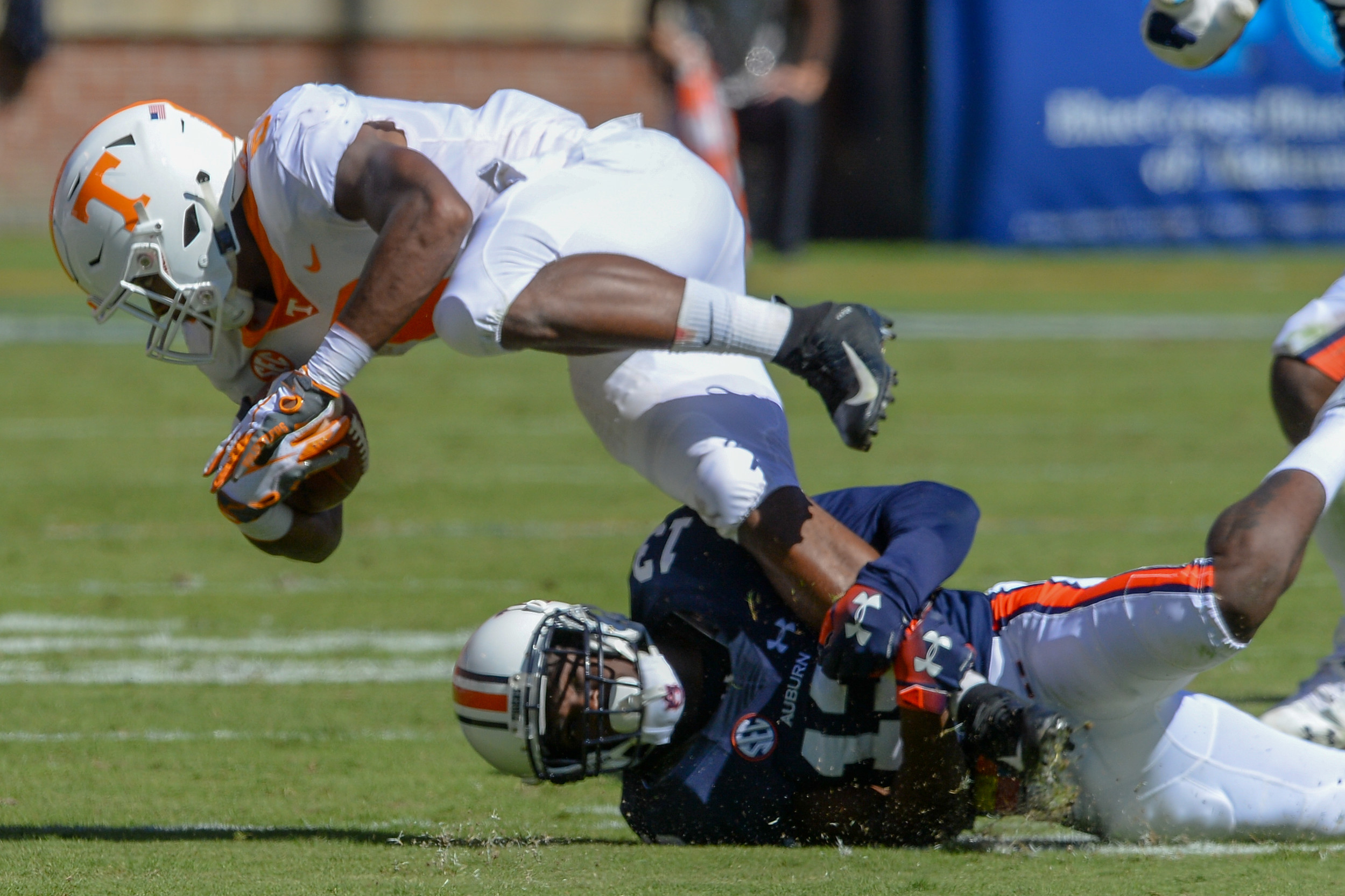 Tennessee Volunteers running back Ty Chandler (8) is. tackled by Auburn Tigers defensive back Javaris Davis (13) during the first half of Saturday's game, at Jordan-Hare Stadium in Auburn, AL. Daily Mountain Eagle -  Jeff Johnsey