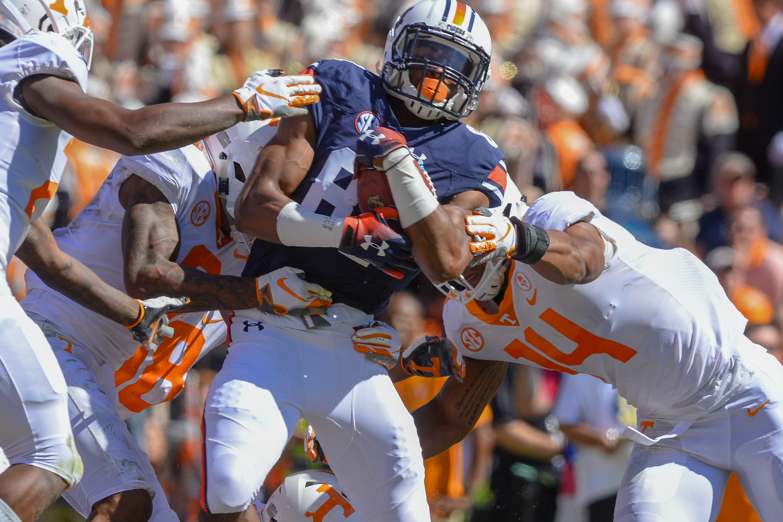 Auburn Tigers wide receiver Darius Slayton (81) is brought down by Tennessee Volunteers linebacker Quart'e Sapp (14) during the first half of Saturday's game, at Jordan-Hare Stadium in Auburn, AL. Daily Mountain Eagle -  Jeff Johnsey
