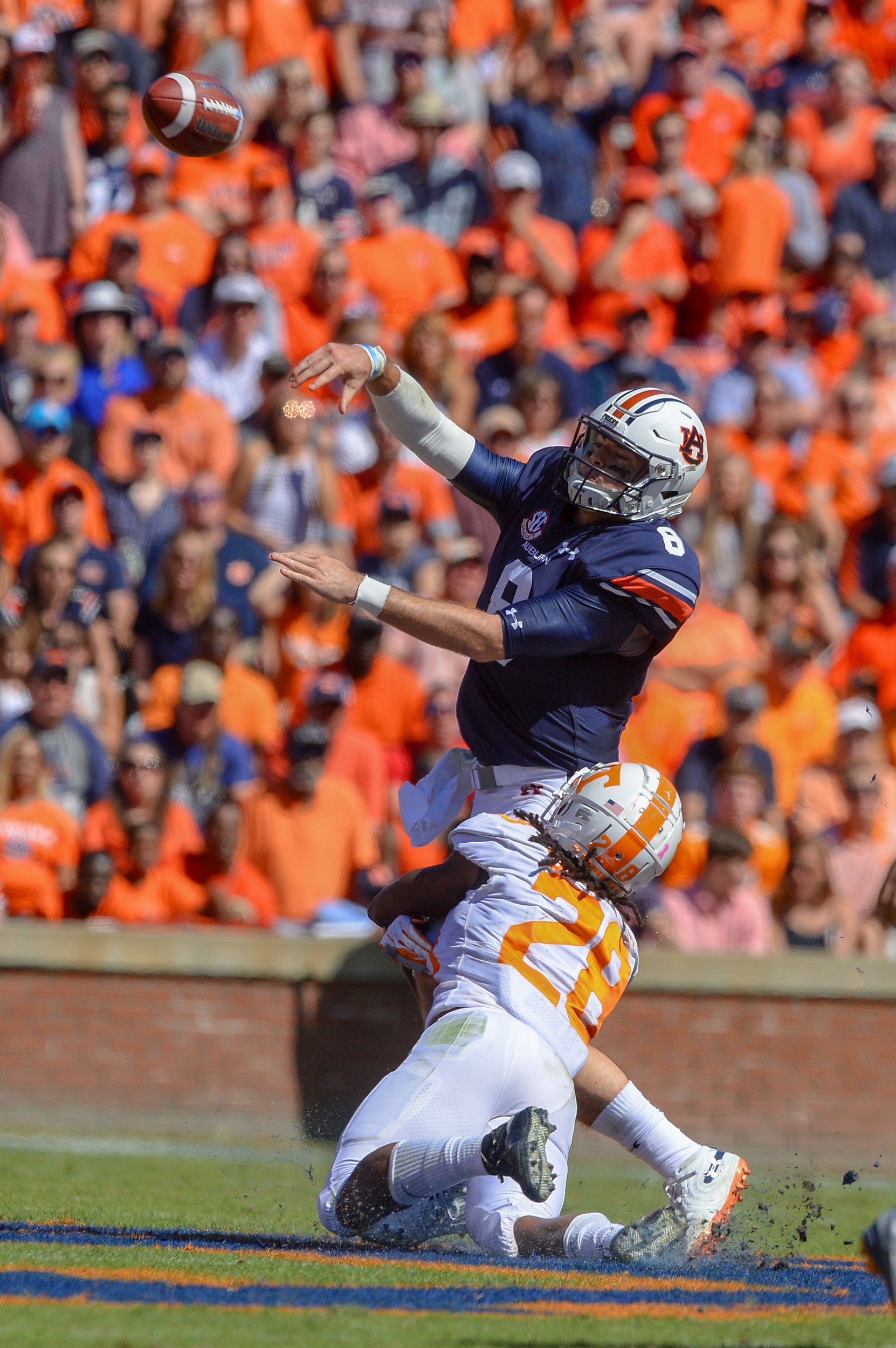 Auburn Tigers quarterback Jarrett Stidham (8) is pressured by Tennessee Volunteers defensive back Baylen Buchanan (28) during the first half of Saturday's game, at Jordan-Hare Stadium in Auburn, AL. Daily Mountain Eagle -  Jeff Johnsey