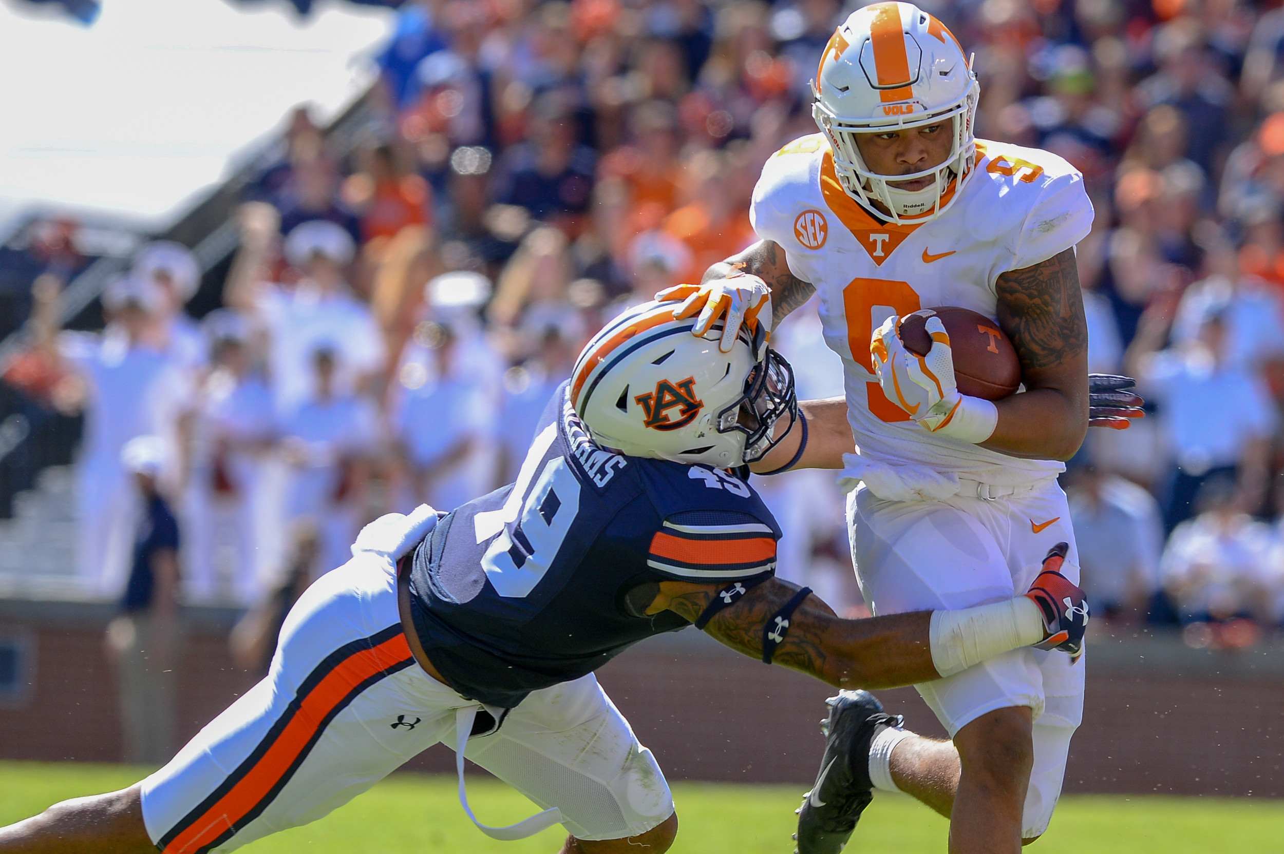 Auburn Tigers linebacker Darrell Williams (49) makes a tackle on Tennessee Volunteers running back Tim Jordan (9) during the first half of Saturday's game, at Jordan-Hare Stadium in Auburn, AL. Daily Mountain Eagle -  Jeff Johnsey