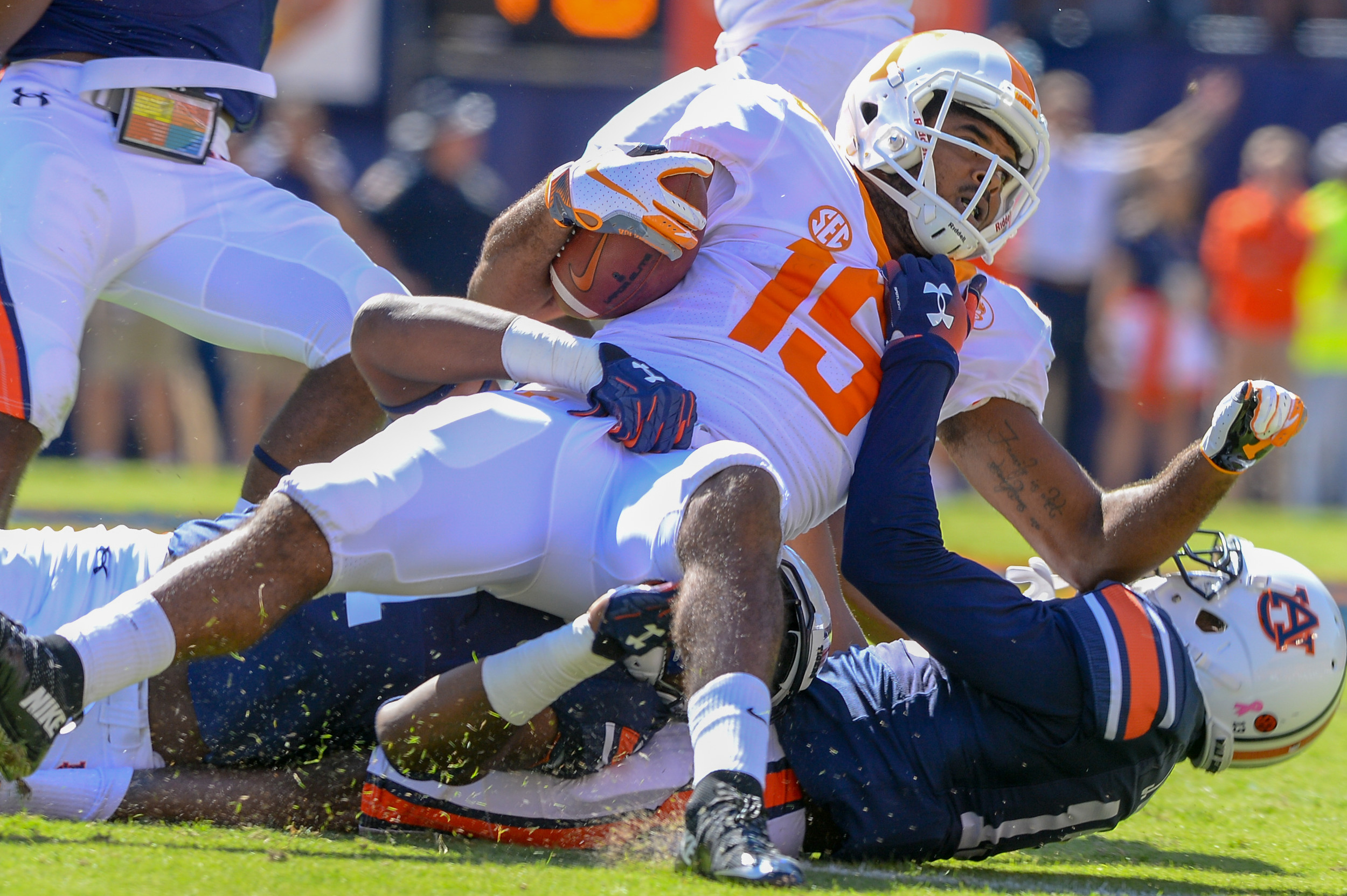 Tennessee Volunteers wide receiver Jauan Jennings (15) is brought down by Auburn Tigers defensive back Javaris Davis (13) and linebacker Big Kat Bryant (1) during the first half of Saturday's game, at Jordan-Hare Stadium in Auburn, AL. Daily Mountain Eagle -  Jeff Johnsey