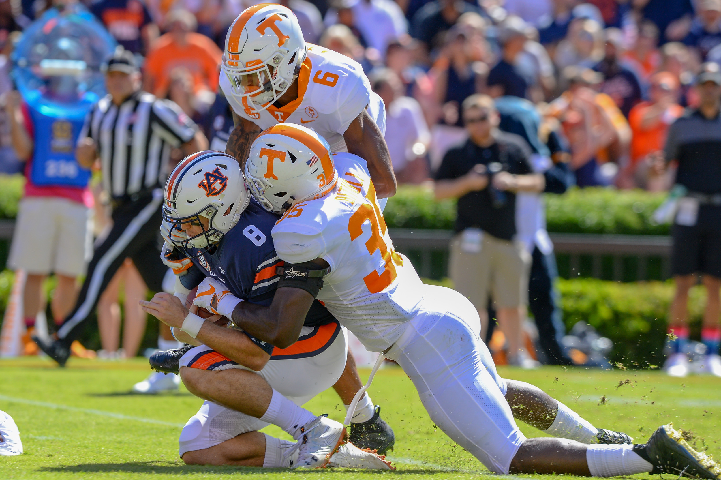 Auburn Tigers quarterback Jarrett Stidham (8) is sacked by Tennessee Volunteers linebacker Daniel Bituli (35) and  defensive back Alontae Taylor (6) during the first half of Saturday's game, at Jordan-Hare Stadium in Auburn, AL. Daily Mountain Eagle -  Jeff Johnsey