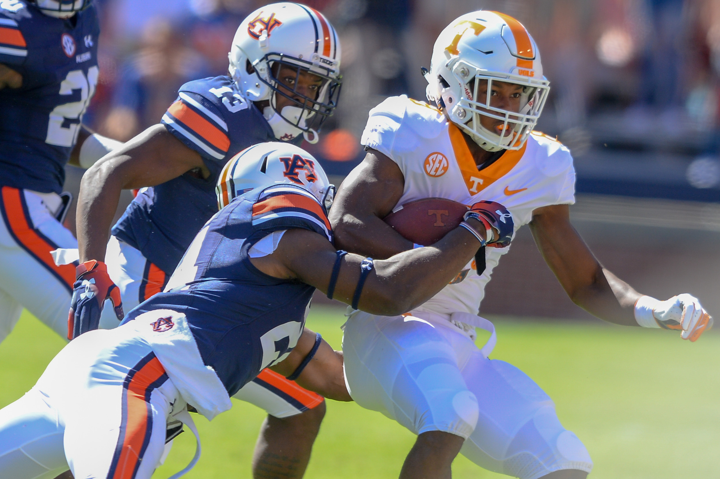 Auburn Tigers defensive back Daniel Thomas (24) tackles Tennessee Volunteers running back Ty Chandler (8) during the first half of Saturday's game, at Jordan-Hare Stadium in Auburn, AL. Daily Mountain Eagle -  Jeff Johnsey