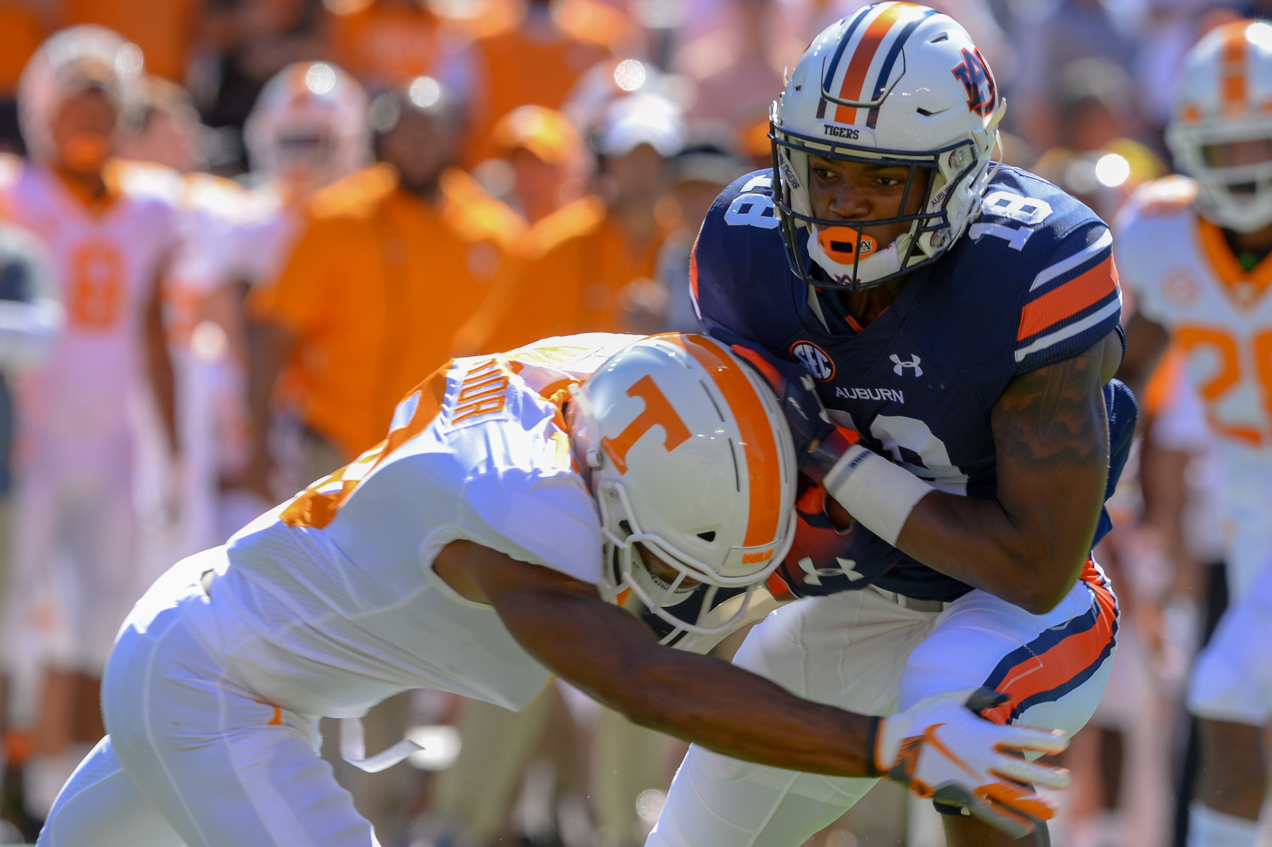 Tennessee Volunteers defensive back Nigel Warrior (18) makes a stop on Auburn Tigers wide receiver Seth Williams (18) during the first half of Saturday's game, at Jordan-Hare Stadium in Auburn, AL. Daily Mountain Eagle -  Jeff Johnsey
