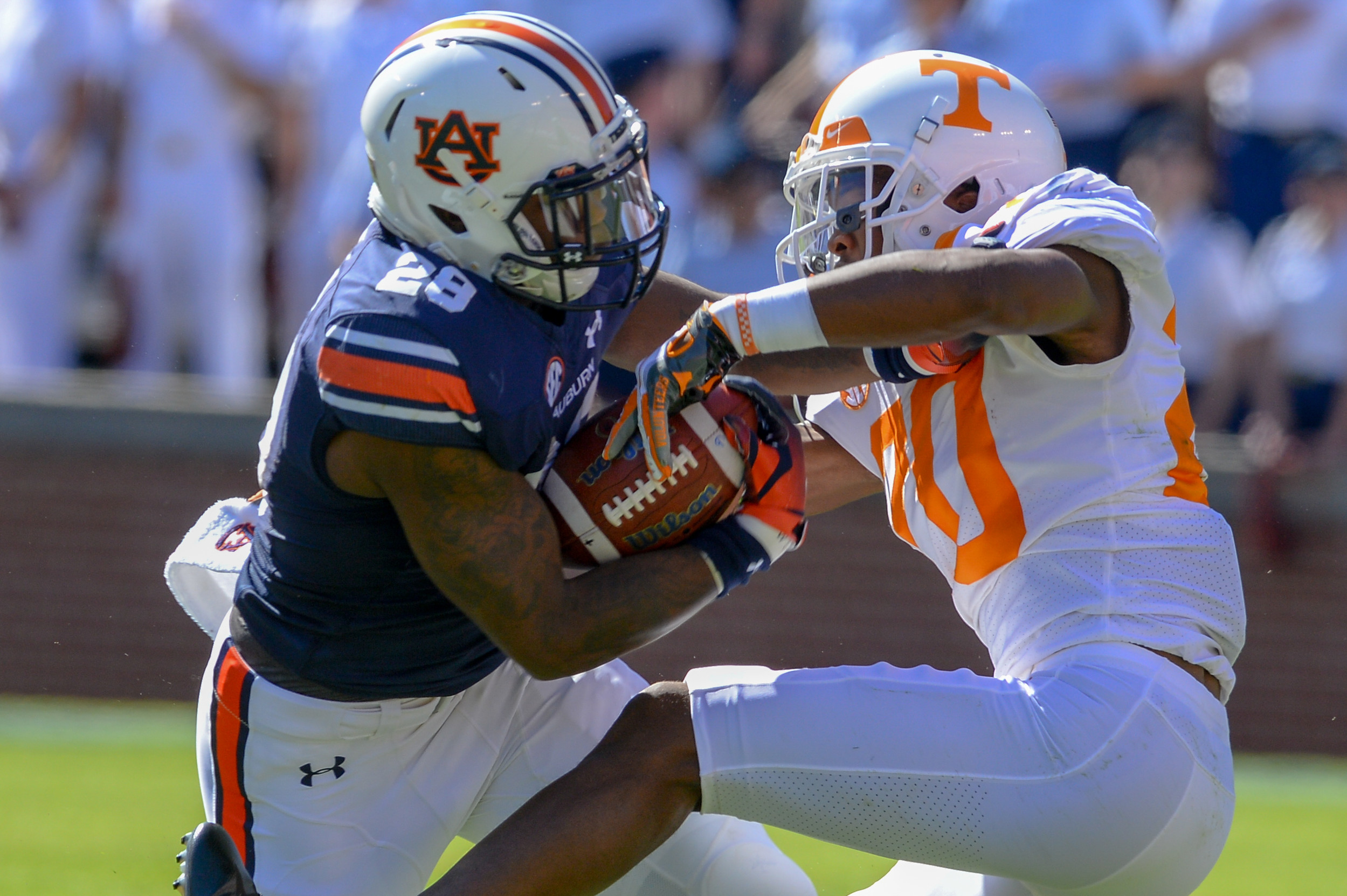 Auburn Tigers running back JaTarvious Whitlow (28) breaks the tackle of Tennessee Volunteers defensive back Bryce Thompson (20) during the first half of Saturday's game, at Jordan-Hare Stadium in Auburn, AL. Daily Mountain Eagle -  Jeff Johnsey