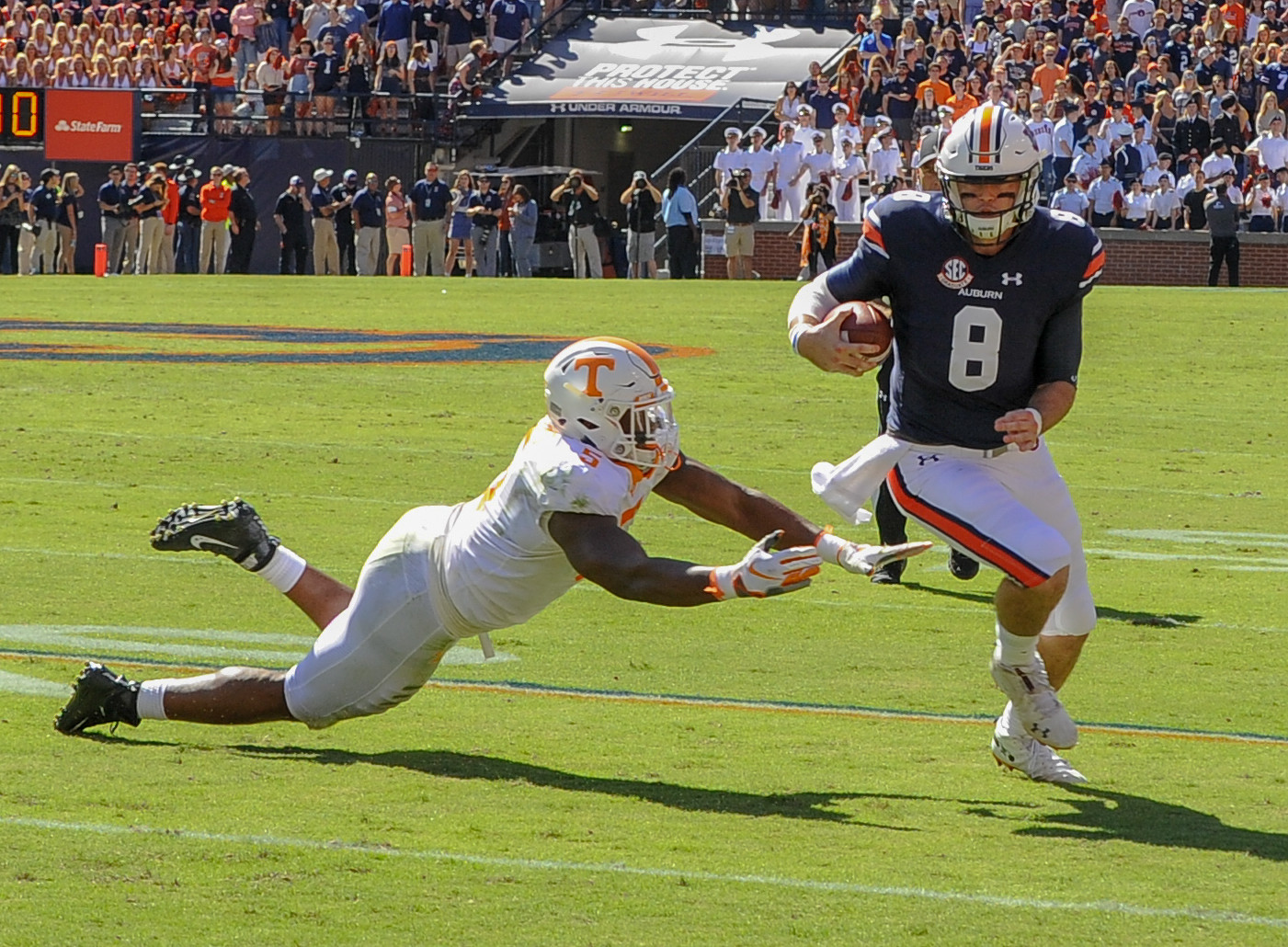 Tennessee Volunteers defensive lineman Kyle Phillips (5) dives for Auburn Tigers quarterback Jarrett Stidham (8) during the first half of Saturday's game, at Jordan-Hare Stadium in Auburn, AL. Daily Mountain Eagle -  Jeff Johnsey