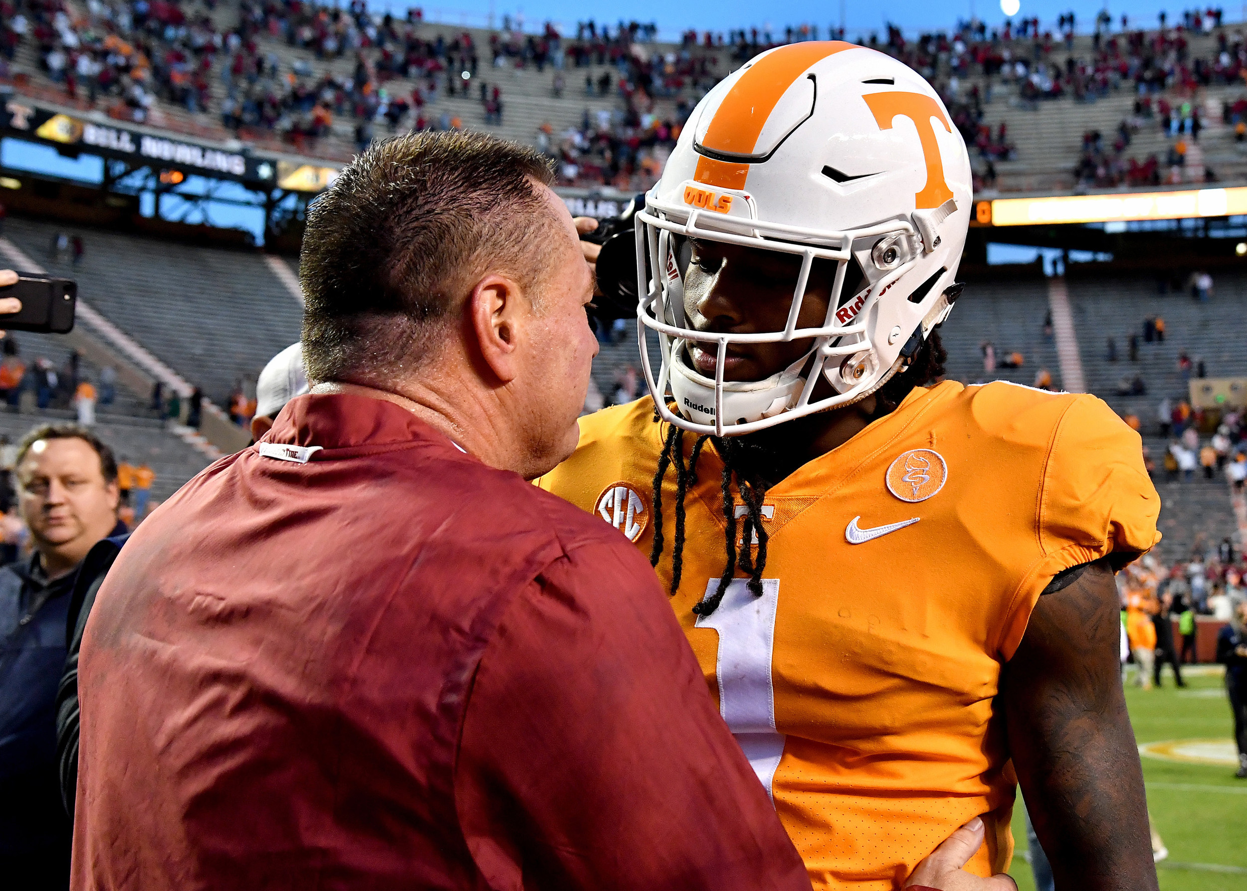 Tennessee Volunteers wide receiver Marquez Callaway (1) talks with his former coach, Butch Jones, following the Alabama at Tennessee NCAA football game on Saturday, Oct. 20, 2018, at Neyland Stadium in Knoxville. Tenn. Alabama wins 58-21. (Photo by Lee Walls)