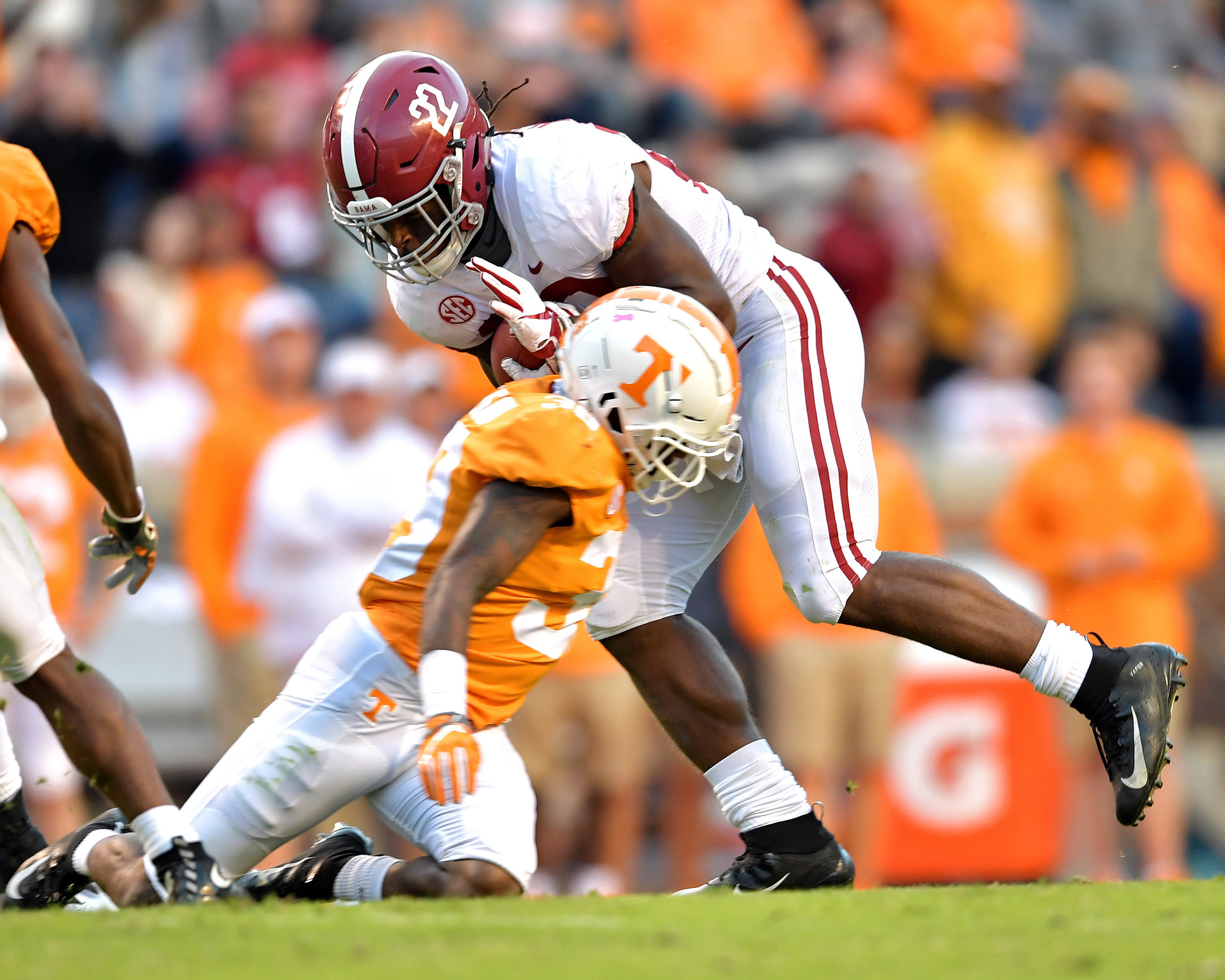 Alabama Crimson Tide running back Najee Harris (22) is tackled after a long run in the third quarter of the Alabama at Tennessee NCAA football game on Saturday, Oct. 20, 2018, at Neyland Stadium in Knoxville. Tenn. Alabama wins 58-21. (Photo by Lee Walls)
