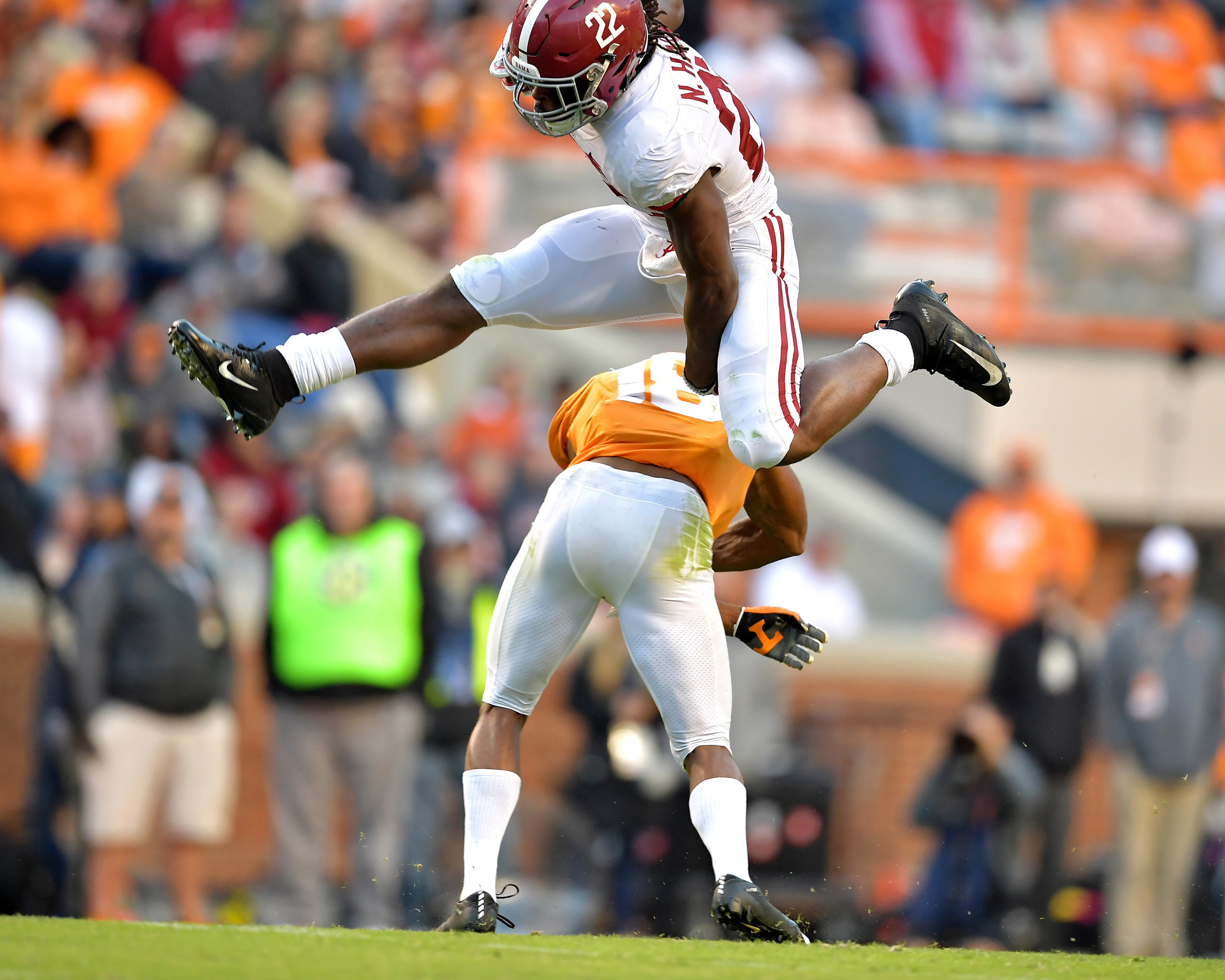 Alabama Crimson Tide running back Najee Harris (22) hurdles a Tennessee player in the third quarter of the Alabama at Tennessee NCAA football game on Saturday, Oct. 20, 2018, at Neyland Stadium in Knoxville. Tenn. Alabama wins 58-21. (Photo by Lee Walls)