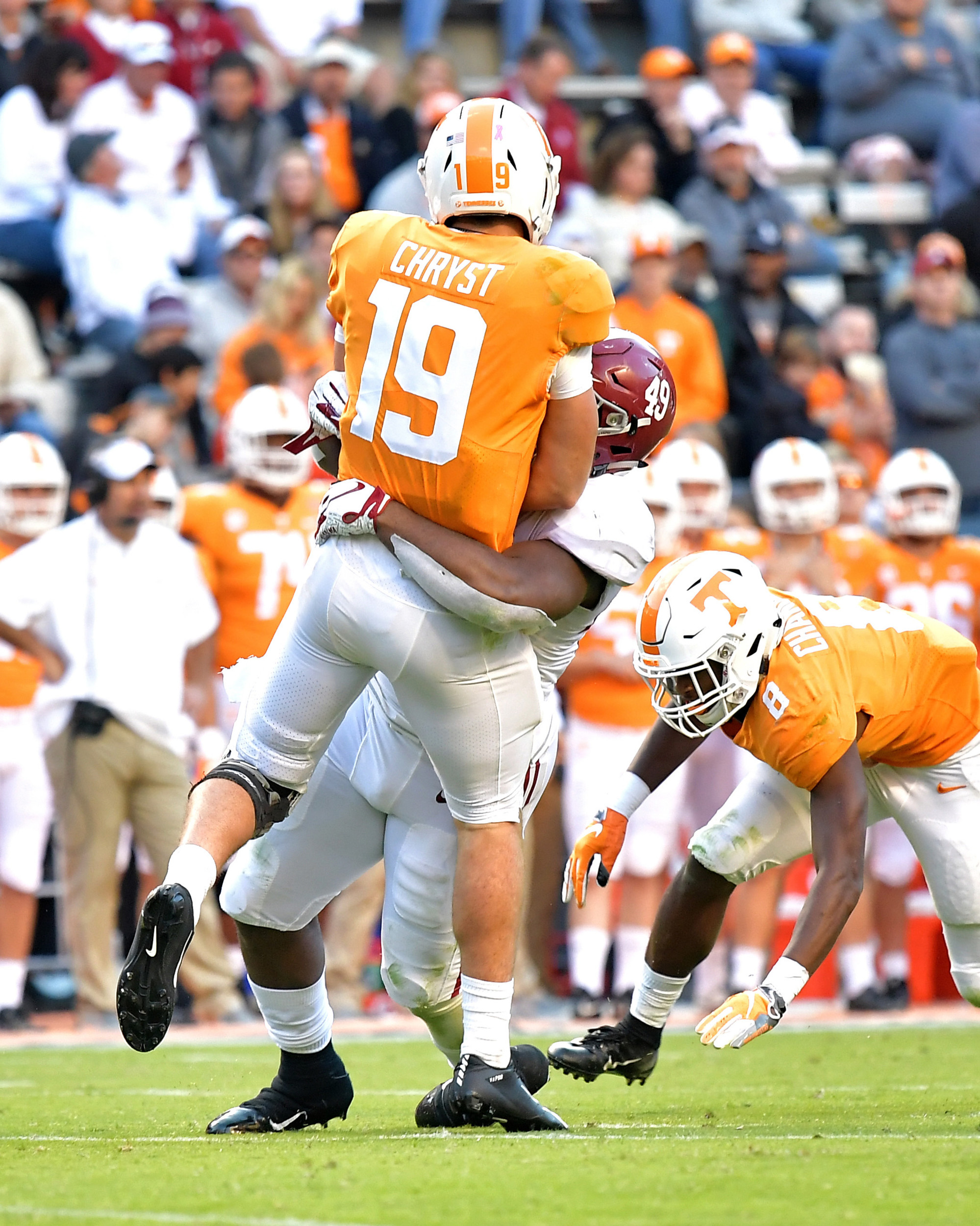 Tennessee Volunteers backup quarterback Keller Chryst (19) barely gets a pass off prior to a hit by Alabama Crimson Tide defensive lineman Isaiah Buggs (49) in the second half of the NCAA football game on Saturday, Oct. 20, 2018, at Neyland Stadium in Knoxville. Tenn. Alabama wins 58-21. (Photo by Lee Walls)